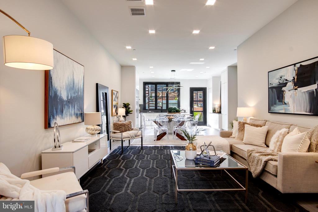 Stunning, brand new (ground-up) offering in The Brason, a luxurious 2-unit boutique rowhome condo just a stone's throw from Blagden Alley & Naylor Court. With almost 2,000SF of unparalleled living space, this 2BR+DEN on 2 levels spares no expense, and results in a contemporary standout in a field of other less impressive condos. High ceilings, accent walls of charred Japanese wood, oversized windows, entry automation system, deluxe lighting (including hanging, stair railing, and cove ceiling) by ELUM Light Design, polished stone baths with Italian floating vanities, magazine-worthy chef's kitchen with Showplace custom cabinets, Bosch appliances, Silestone counters, abundant storage, & more. Lux living with all the amenities (and without high condo fees) in a highly-coveted neighborhood steps to parks, critically acclaimed restaurants, popular boutiques, grocers & more. Bricked walled shared rear yard with plantings (secure PKG available for sale).
