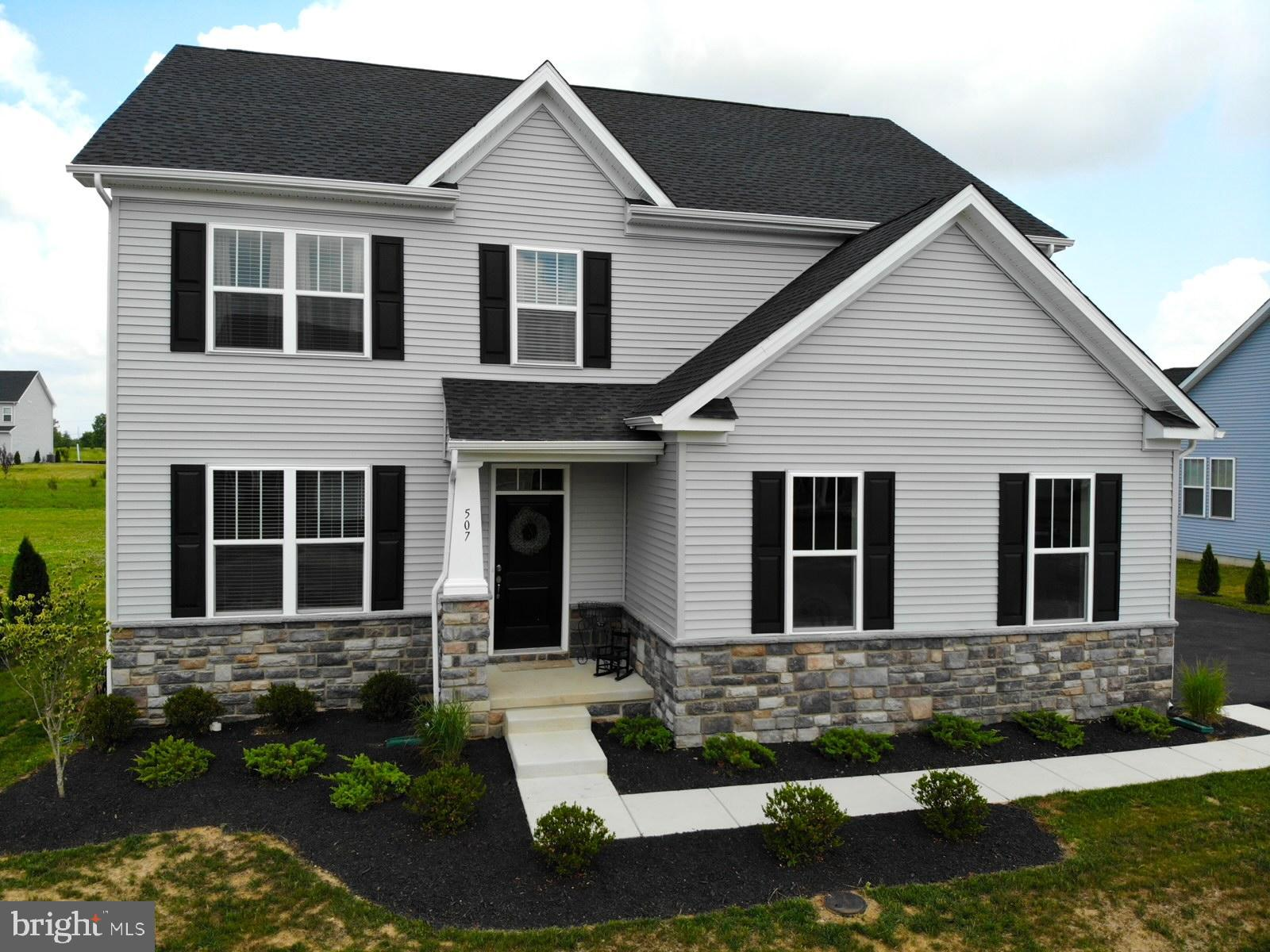 Looking for a brand new home, but don't want to wait for new construction?  This beautiful 5 bedroom, 3.5 bathroom home is only a few months old and ready for you to move in!  Take advantage of the builder~s home warranty and extensive manufacturer warranties on all of the NEW appliances- including the washer & dryer in conveniently located upstairs laundry room.  The home includes many energy-efficient features including 2x6 construction, energy efficient gas furnace, tilt-in insulated double pane windows, and more. With an open concept floor plan, upstairs loft and finished basement, there is plenty of space to live and entertain.   Upon entering the home, you will notice that the cool, dark-toned hardwood floors start in the foyer and run throughout the kitchen and into the formal dining room.  Off the foyer, is an additional living space that can be used as an office, playroom or formal living room.  The expansive kitchen boasts a large island with stainless steel appliances, sparkling granite countertops, a white subway tile backsplash and plenty of space for a breakfast nook.  It opens to a spacious living room and glass sliding door to the backyard.  Upstairs, lies a spacious master bedroom with ensuite bathroom and both his and hers walk-in closets. You will also find an open loft space for lounging, full hall bathroom with tub-shower combo and 3 additional bedrooms, each with it's own walk-in closet.  The basement level is mostly finished with a large bonus room, full bathroom and bedroom with large egress window for light and safety.  Additionally, the basement contains an unfinished space for appliances and ample storage. Take advantage of Middletown~s awesome location- one hour to the beach, 45 minutes to the Philadelphia airport and only 20 minutes to tax-free shopping at Christiana!  With all these fine details, this home is sure to sell quickly.  Schedule your private showing today!