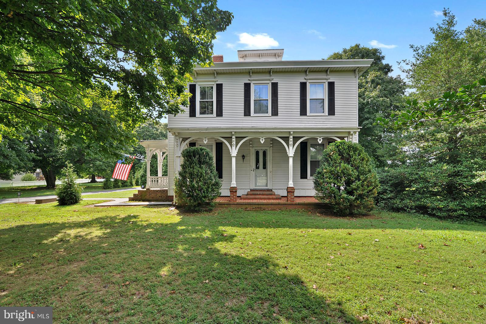 This Mansard Federal Style home is a one of a kind property that will take your breath away.  This 2.5 +/-  acre oasis is located close to everything but you would think you were in the middle of nowhere sitting on the rear deck.   The original home was constructed in 1850 and there have been obvious additions and updates since.  Featuring 4 spacious bedrooms, 2 Full baths and plenty of room to reconfigure for additional beds/bathrooms.  The property also includes two large outbuildings with unlimited potential and endless parking.  You have to see all this home offers to believe it.