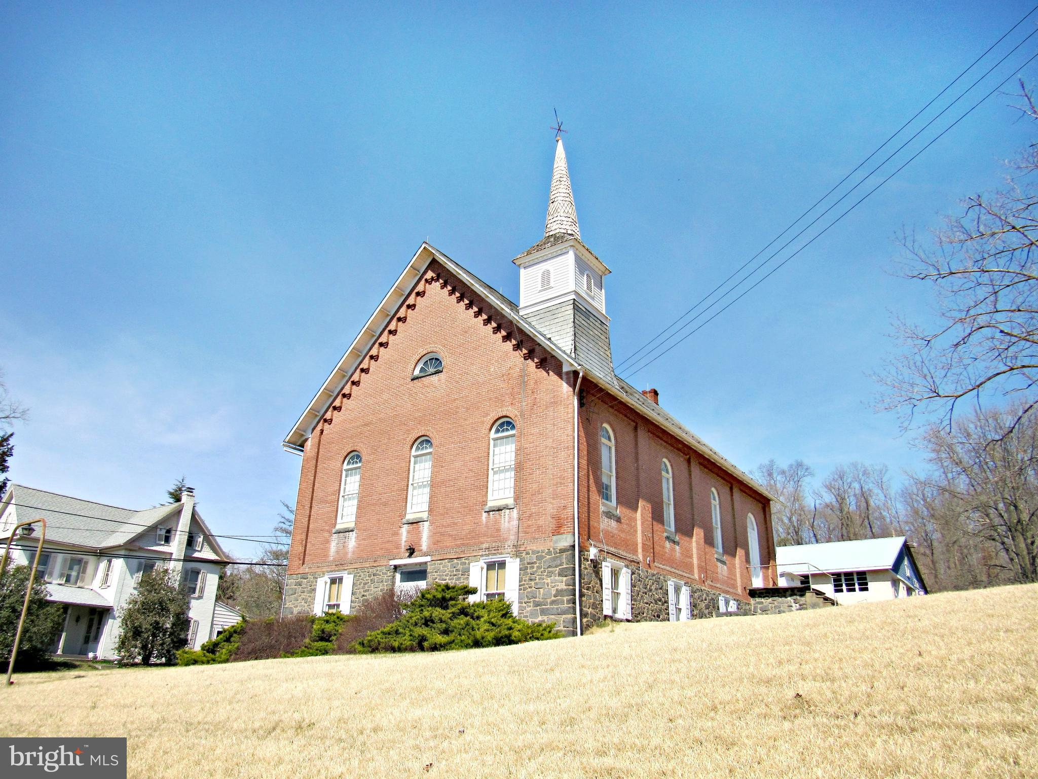 Wonderfully maintained chapel built in 1898. Upper level is a worship area that is 34' x 45' plus large stage. Current seating for approximately 175. Lower level meeting room is 32' x 34'. Lower level also has entrance foyer with two stairways heading to upstairs, heater room and storage room. Building has heat, but no interior plumbing. Use your imagination. Many possible uses. Current zoning Borough Residential which does permit professional office and some commercial use. Call listing agent for details.