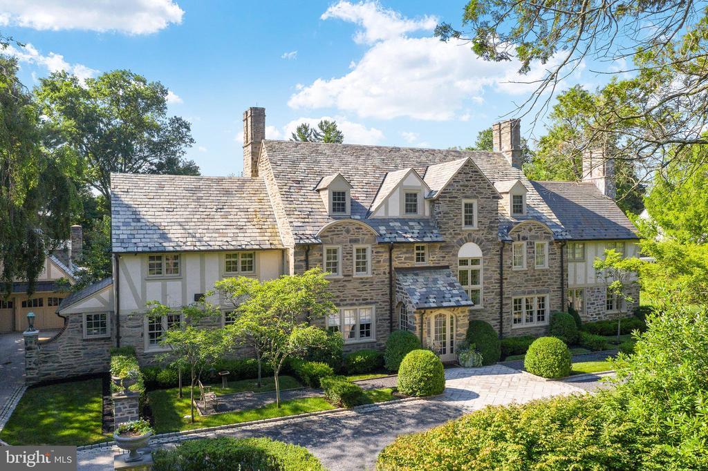 Welcome to this breathtaking, gated residence with entrance courtyard majestically set on over an acre of stunning Gale-designed grounds and gardens in the highly coveted Merion Golf neighborhood.  The impeccable interior and exterior renovations and masterful expansion of this sun-filled 1920's stone Normandy home including a fabulous pool with spa, English pool house with full bathroom and Joanne Hudson kitchen, and charming 4-car carriage house with potential living space above,  will please the most discriminating buyer at every turn. Move right in and enjoy the very private setting with gracious room sizes for comfortable living and effortless entertaining, an open flow, high ceilings, beautifully restored original floors, millwork, moldings and architectural details, incredible Joanne Hudson chef's kitchen with La Cornue cooktop and hood, double Wolf wall ovens, Sub-zero refrigerator, freezer and drawers, large family room expansion with bright widows and French doors leading out to the private terraces and grounds, inviting Master Bedroom Suite addition with luxurious marble bath and his and hers dressing rooms, 4 additional spacious bedrooms with 2 beautifully renovated en-suite baths and one  hall bath, artistically designed exterior terraces and a new expansive entertaining loggia with stone fireplace. This timeless treasure offers a peaceful retreat while also being located just minutes away from trains, world class shopping and restaurants, Center City Philadelphia, renowned schools, recreational facilities, Philadelphia International Airport and 90 minutes from New York City.***Walkthrough video at: https://www.seetheproperty.com/r/355456***
