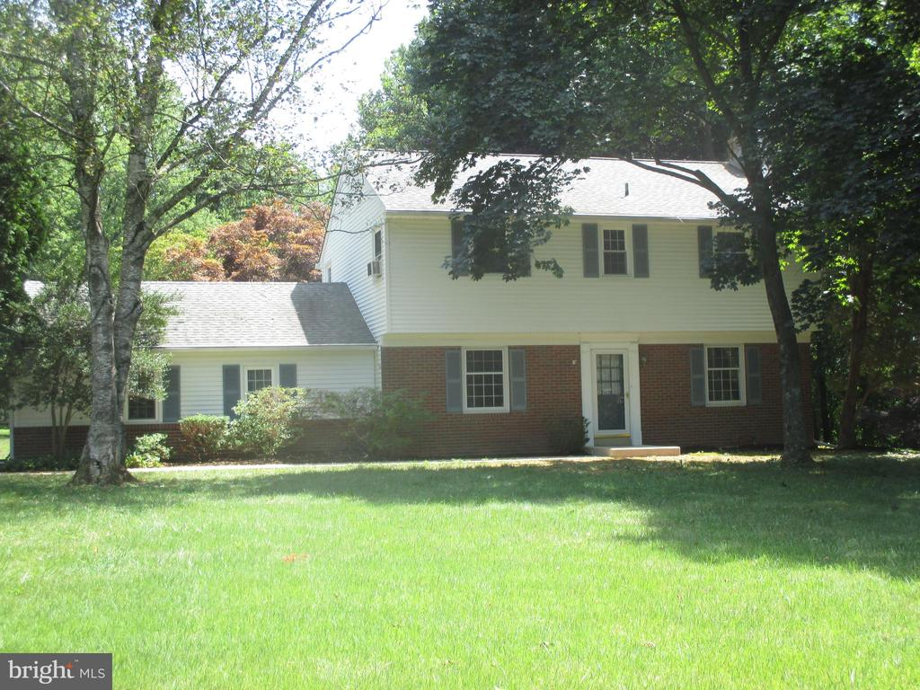 Don't wait to see this four bedroom, 2.5 bath center hall colonial on 1.4 flat acres in East Goshen Township. Major improvements include the windows, roof, septic system, well pump, siding, and furnace. Wood floors upstairs and down, recently painted, double doors from the living room to the patio, wood burning brick fireplace, numerous closets, pull down stairs to the floored attic, four large bedrooms, two car garage with new doors and opener, large walk-up, block foundation basement with shelving, Invisible dog fence, Fios, and new Peerless boiler that was just serviced. Convenient to Rts 30, 202, Exton, King of Prussia, and West Chester. Easy to show. Have your agent schedule a showing today.