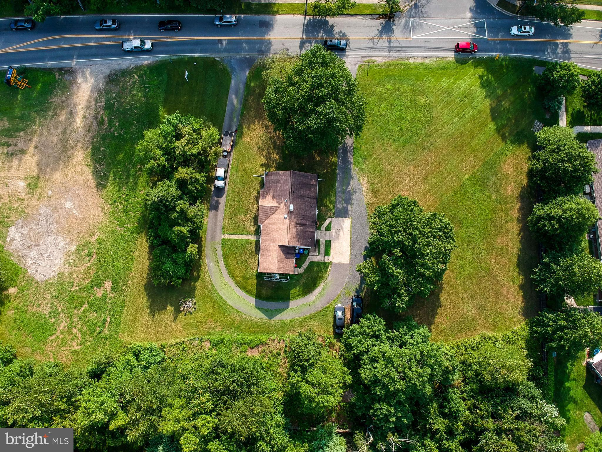 COMMERCIAL OPPORTUNITY! One acre of open land on the corner of 2 highly traveled roads, Route 70 and North Elmwood Road.  HIGH visibility. VALUE is in the LAND ONLY. Perfect location for your professional office with easy access for all your clients. This is a rare opportunity in a rapidly expanding community.