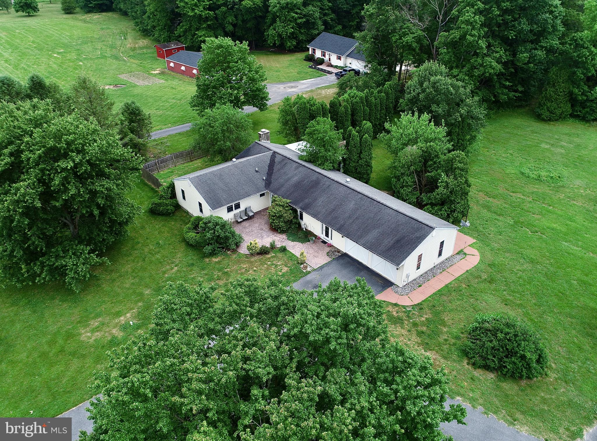 Visit this home virtually: http://www.vht.com/434090315/IDXS - This is the unique opportunity you have been waiting for! Single story living in this 3 bedroom, 2 full bath ranch home on 10 acres with over 200k in upgrades! Bring your horses, four wheelers, hunting stand, row boat and fishing pole to enjoy all that this home and 4 wooded acres, several cleared acres plus beautiful pond with lily pads has to offer. Tile foyer entry, updated kitchen including new cabinets with crown molding, beautiful granite countertops, double wall oven and cooktop and tile flooring. Spacious family room with bar and fresh carpet, large dining room and living room with tile flooring, brick wood burning fireplace in the living room, enclosed porch off of the living room. Hall bath with shower and Jacuzzi tub, master suite with private bath. New well in 2014, 20' X 30' pole barn, the possibilities here are endless! Hurry and make your appointment today!