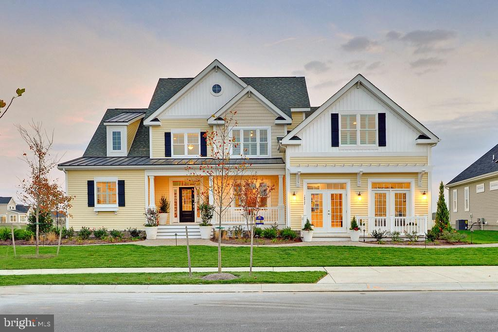 Walden is a new community in the Lewes area tucked away from the coastal hustle and bustle. Enjoy water access for kayaking/fishing on Burton's pond and the variety of community amenities including clubhouse with fitness center, rec room and bar, outdoor pools, courtyard with tiki bar and BBQ area, 2 pickleball courts, multi-use court (tennis/basketball), playground and walking paths. The Henlopen plan is a two-story home with first floor owner s suite starting at 2,783 heated square feet. Includes 4 bedrooms and 3 full baths. The kitchen is open to the spacious great room with bar seating at the island with a breakfast nook and formal dining room. Upstairs includes 2 bedrooms, a full bath and unfinished bonus room. Options are available to personalize layout with additional bedrooms, baths, and outdoor living spaces.  *Base price includes $20,000 incentive value *Photos re of a model home with upgrades. Unlicensed onsite sales professional represents the Seller only. Sales office open off-site by appointment only.