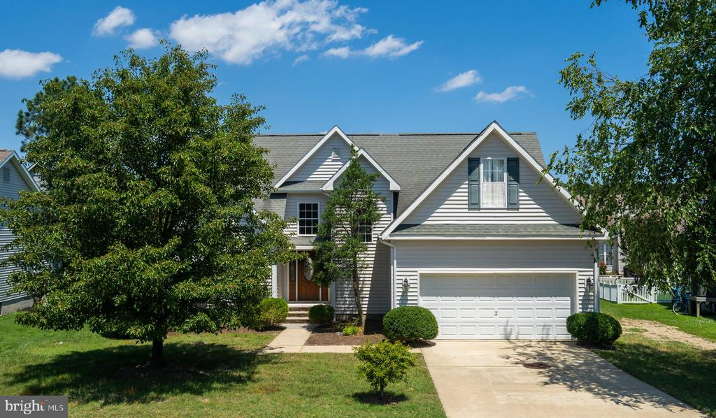 Price Reduced! Beautiful home in desirable Oyster Harbor located just 2.5 miles from Ocean City Maryland and a short distance to a Blue Ribbon elementary school. This spacious  4-bedroom home features vaulted ceilings, a first floor owners suite with a walk-in closet, formal living room with fireplace, separate dining room, granite kitchen countertops, stainless steel appliances, and eat-in breakfast area. The garage has been converted to an oversized family room with a fireplace and could easily be changed back into a garage. Additional features include a screened porch and a backyard patio with a garden arbor, and two brand new top of the line HVAC units. Neighborhood amenities include lawn service, trash/recycle service, street lights, and a beautiful community pool! The HOA dues are $320 a quarter.