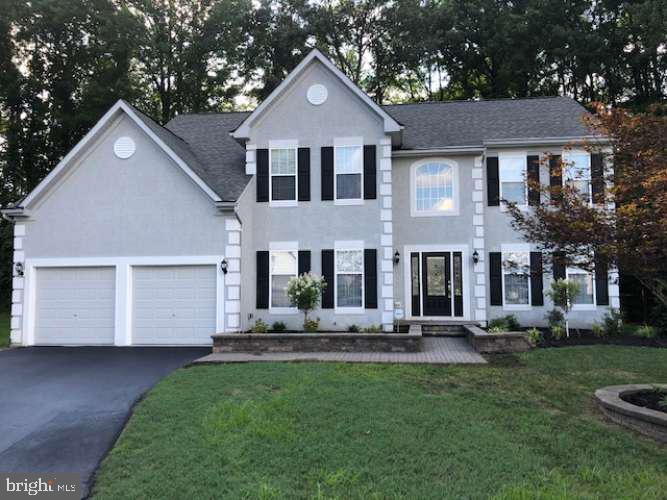Beautiful, well-maintained and spacious two-story colonial in the desirable community of Deerborne Woods. Includes 5 bedrooms, 4 bathrooms, a two car garage and a large basement . This property is located at the end of a quiet cul-de-sac with a secluded rear yard backing up to tree-filled land. Enter the home into an elegant 2 story foyer with a turned stair way centers the formal living and dining rooms. This open floor plan leads you to a beautiful eat-in kitchen with a center island and a large family room with a gas fireplace. Also, it includes sliding doors to a custom hard scape patio with a fire pit creating an attractive outdoor entertainment space. Main floor also features a bathroom, laundry area, garage entry and a home office with custom cabinetry. The kitchen includes 42~ white solid wood cabinets with stunning granite tops. All stainless steel appliances, recessed lighting and hardwood floors. Take the front stairwell or the back stairwell to the upstairs where you will find 5 full bedrooms and 3 full baths. Master bedroom features a walk-in closet and a private master bath with double sinks, sunken tub and shower. A second master bedroom features a private full bath. Further down the hall you will find additional 3 full bedrooms and another full bathroom. New carpet, all windows include new vinyl blinds, entire home interior freshly painted with light earth tone color. Seal coated driveway. Brand new Trane 96% high efficiency gas furnace with central AC. Architectural asphalt roof shingles. Professionally landscaped with premium plants, stone walls and rear fencing. Conveniently located off of Route 95, Route 40, Route 896. Be advised to use zip code 19702 because there is another same address with a different zip code.
