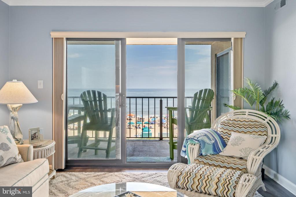 Price Reduced! Enjoy breathtaking ocean views at the Marigot Beach Condominium on 10002 Coastal Hwy. Unit 312 in North Ocean City, MD. This luxurious oceanfront end unit has been fully remodeled. The kitchen is complete with granite, counter seating, soft close cabinetry, and features a separate dining area. The living room is extended with an oceanfront balcony and the open concept floor plan offers ocean views from all these rooms. The oceanfront owner~s suite comes complete with access to the balcony overlooking the sandy beach and crashing waves. This beautifully decorated and nicely furnished condo features custom window treatments by Designing Windows due to arrive mid-September. The Marigot Beach building has full access to amenities at the neighboring building the Clarion Resort Fontainebleau Hotel.  Amenities include an indoor pool, outdoor pool with hot tub, poolside bar, exercise room, health club and spa with a sauna, Horizons Oceanfront Restaurant, Lenny's Beach Bar & Grill and Ocean Club Night Club. Great location with easy access to MD Rt. 90 and Rt. 54 from the Maryland Delaware line. Two assigned parking spaces and on-site overflow parking. This home is the perfect beach retreat or investment property.