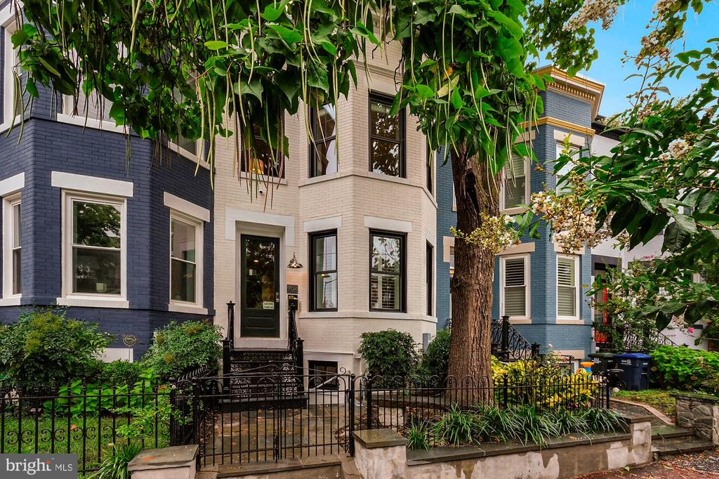 Find your heart and soul  in  the  H Street Corridor, in this recently renovated 3 level  Victorian row home.  Built in the 1908, this home combines the best of old world charm and modern functionality. The exterior of the home is just as gorgeous as the interior with a lush green front yard that showcases a 70 year old catalpa tree planted by one of the owners when he was just 8 years old  along with a gorgeous black wrought iron fence and front stoop.  Upon entering the main level of the home,  you are greeted with soaring 9.5' ceilings  with crown molding, a bay window with plantation shutters, and gorgeous hardwood floors. The  generous kitchen divides the living room and the dining room with custom cabinetry that extends to the ceiling offering plenty of  storage. The kitchen counters are made of Italian Carrara marble and the appliances include  a French door KitchenAid (Maytag) refrigerator, Bosch dishwasher and under counter beverage center. The double French doors lead to the piece de resistance of the home, an outdoor oasis that was custom designed by an award-winning landscape architect. All of the plants (with the exception of the pear tree) are evergreen and keep their gorgeous color year round. The foliage provides both beauty and privacy, the magnolia has gorgeous white blooms and the rose bushes out front are the envy of the block.. There is also a working stone fire pit and plenty of space to grill out, entertain or just enjoy morning coffee and truly feel like you are tucked away and secluded in your own world.  Heading upstairs, are 2 large bedrooms and a master suite with an en suite bath which includes a double bowl vanity and oversized walk-in shower along with skylight. The master bedroom has vaulted cathedral ceilings and a huge walk- in closet with built in shelves (along with a second separate closet) The second bedroom is full of storage as well with built in book shelves and another large closet with Elfa shelving installed. The second ba