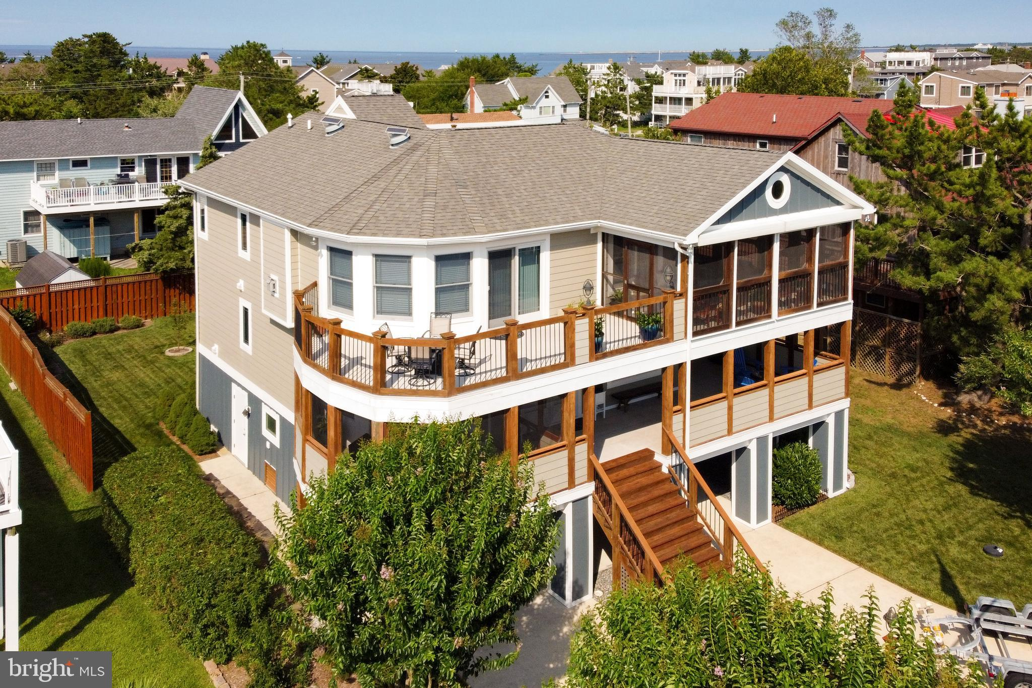 WATER VIEWS AND ROOM FOR A POOL IN THIS UNIQUE LEWES BEACH ENCLAVE. Pick your perch: rooftop deck, wraparound porch, or sands of Lewes Beach! Well-equipped coastal home delivers water views, bay breezes, and updates to seal the deal. Welcome to solid construction & room for relaxing featuring 4+ bedrooms & 2.5 baths, including an owner suite on the second level with private screened porch access, 2 walk-in closets, and luxe en-suite bath. Entertaining is easy with a modern open kitchen, dining, living design on the top level, along with an office/5th bedroom accessible through pocket doors just off the living room. The ground level completes the package with workshop, outdoor shower, spacious fenced-in backyard - providing room enough for a future in-ground pool - and plenty of storage for beach & boat gear! Enjoy peace of mind from  conscientious build choices such as hurricane shutters, solid doors & hardie-plank siding, and a sump-pump water management system.  Located just steps away from the canal and the beach. The scenic Rehoboth-Lewes Canal and Delaware Bay await you; call & schedule your showing today! *Seller hired architect to create plans for redesign and renovation of exterior and top floor.