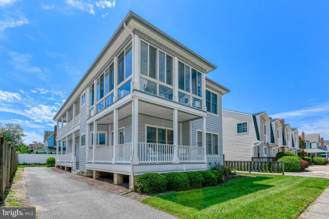 Ocean View-Ocean Block Home-North Rehoboth.-just steps to the beach.  Great views of the ocean from the second level 3 season room.  This 5 bedroom, 4.5 bath home offers a reversed floor plan to maximize views.  Offering 4 bedrooms & 3 baths on the first level and the living-dining-porch and a master bedroom on the second level.   The expansive kitchen is perfect for entertaining.  The perfect family retreat home or investment property.  Rental potential of $100,000.  The market is hot...buy today while the rates are low!