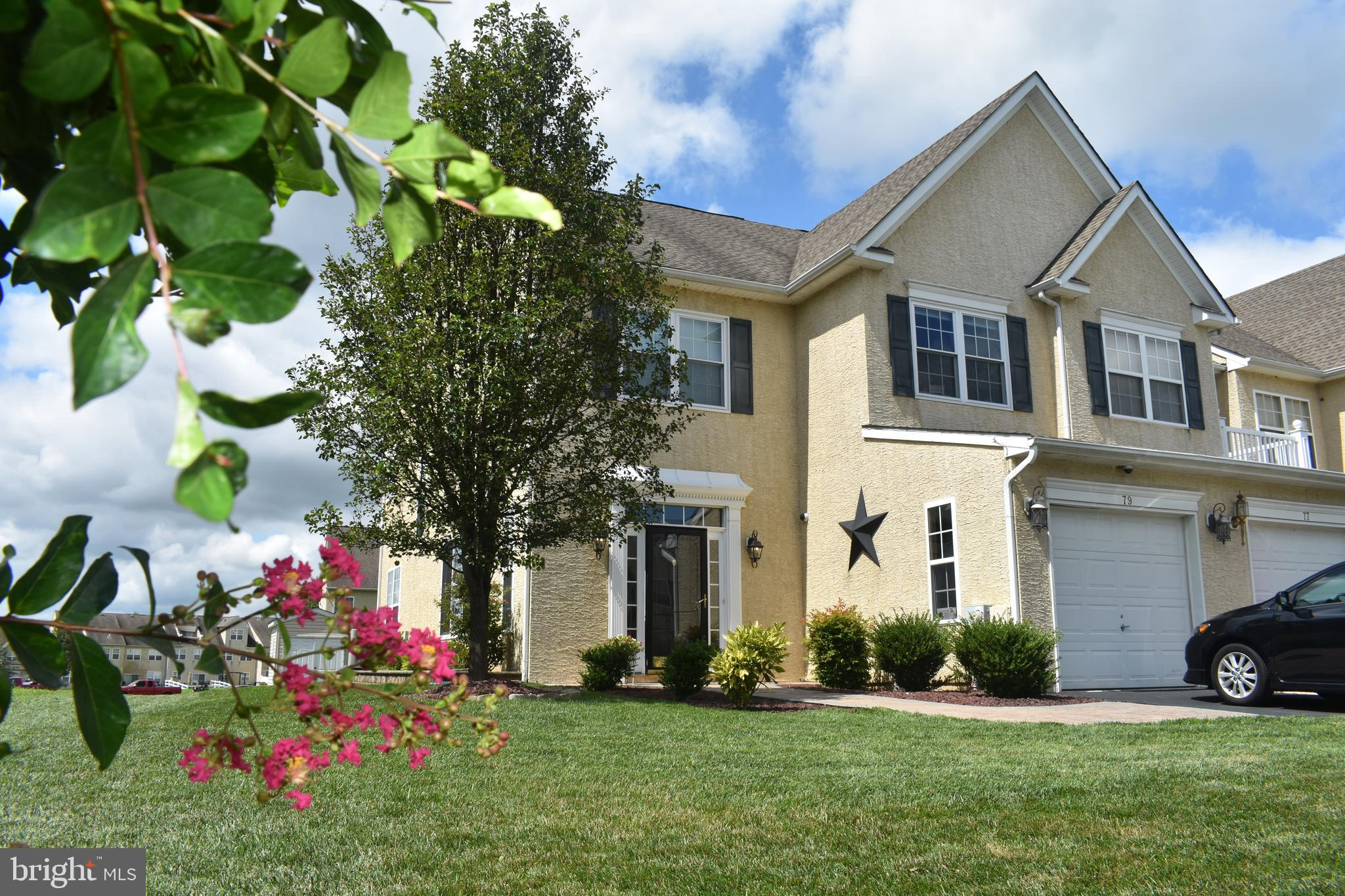 """Conveniently located three-bedroom end-unit townhome in the Appoquinimink School District all ready to move in. Beautiful paver walkway lead to the private entrance surrounded by a meticulously maintained landscaped  and hardscaped property with additional open space surrounding The gracious foyer with coat closet and half bath leads into you into the main level offers rich wood flooring, oversized living room window to bring in natural lighting. A sun-filled picture window fills the living room with natural light creating a welcoming atmosphere. The gorgeous kitchen features stainless steel appliances plenty of 42-inch cabinetry, granite countertops and backsplash. Enjoy casual meals at the breakfast bar! The kitchen overlooks the family room complete with a French glass door to the paver patio. Entertain guests in the formal dining room surrounded by large windows. Previous owners have converted garage into an especially useful space, ideal for an office, playroom, bonus room, it is complete with built in cabinetry, carpet and ceiling fan.   A convenient laundry room off the kitchen completes the main level.   Washer and Dryer and Refrigerator  and Aquasana Rhino whole house filtration system are included in the sale.  Hardwood treads lead up to the second level loft area.  The master suite draws you in with a wall of sunny windows. This retreat offers a large walk-in closet featuring """"Closet by Design"""" solution , a soaking tub, separate shower and a double vanity. Two additional bedrooms (one with another nice walk-in closet), share a nicely appointed hall bathroom. A beautiful paver stone patio provides a great outdoor entertaining space. Relax with friends while surrounded by open area and beautiful landscaping! Outdoor storage shed provides another great storage potential. Great neighborhood conveniently located for commuting, shopping or entertainment.  Owner has just completed many refreshes on the home including painting, carpet cleaning as well as some rec"""