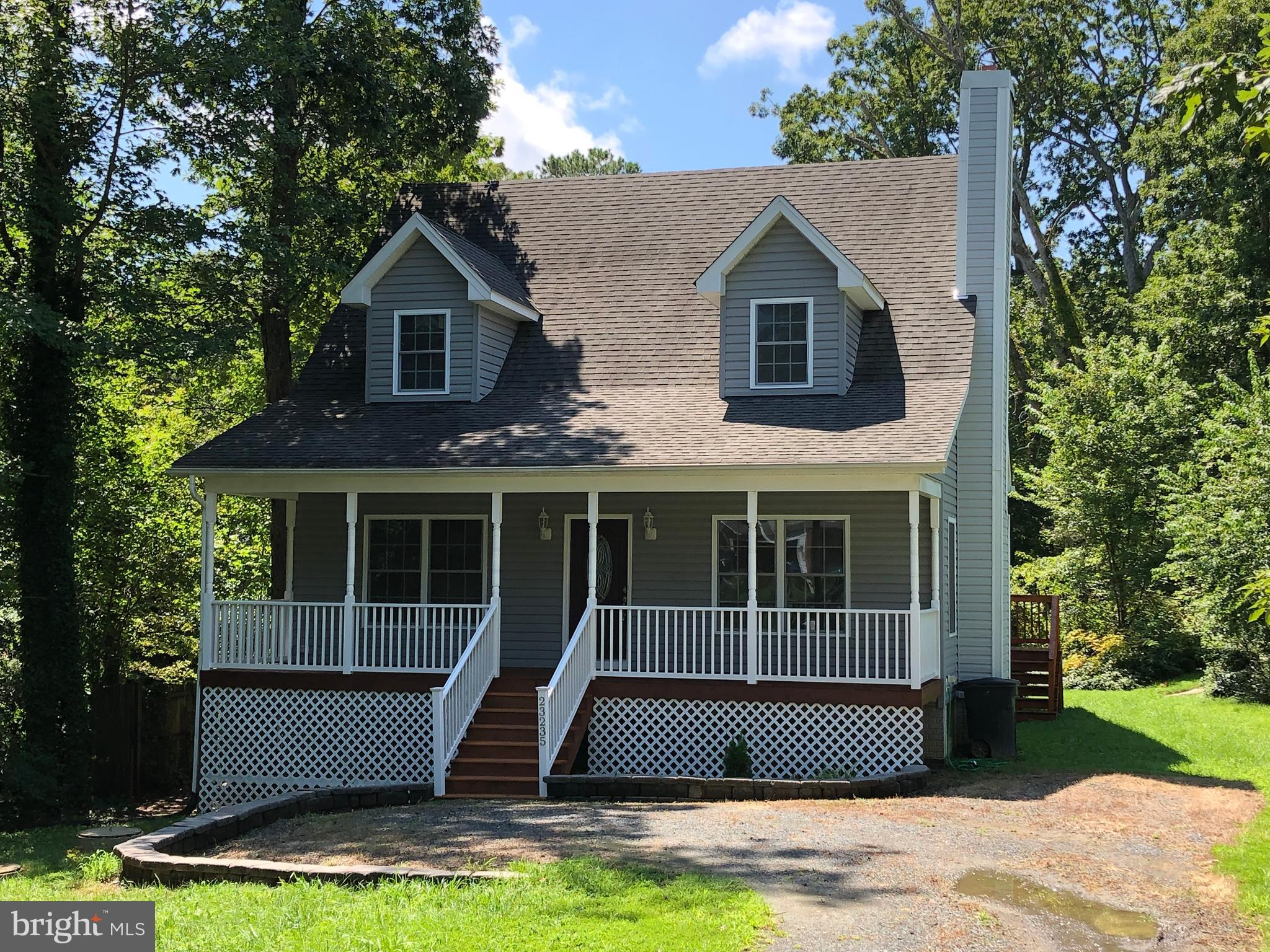 MAIN LEVEL MASTER SUITE! LOVELY CAPE COD -3 Bed / 2.5 Bath on  little over 1 acre to call your own within minutes to all the shopping centers & Pax River Base. COVERED PORCH, SPACIOUS OPEN Floor-plan, WOOD FIREPLACE, UPGRADED kitchen w/ SS Appliances, Double SS Sink, Laundry Room w/ FRONT LOADING Washer & Dryer, MAIN FLOOR MASTER SUITE!! (Hard to find!)  GORGEOUS master bath w/ SOAKING TUB, SEPARATE TILED SHOWER STALL.  FULL unfinished basement w/ roughed-in plumbing and separate entrance.  Home looks nicer in person - pics don't due it justice!  Have your pre-approval ready because this home is MOVE-IN READY so get your showing scheduled ASAP so you don't MISS OUT on this one!!!