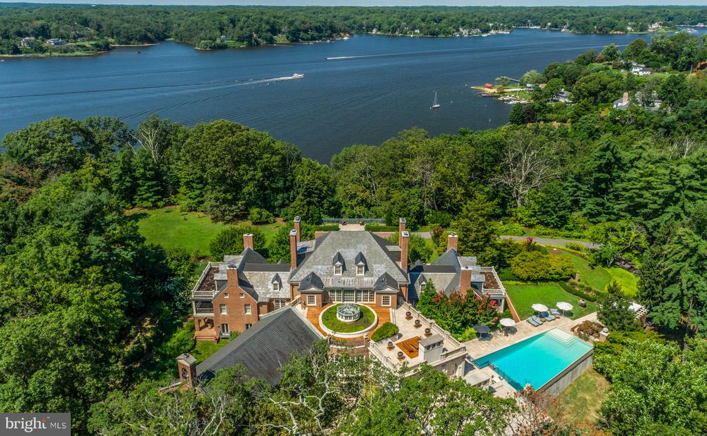Set on 23 private acres overlooking a gracious bend of the Severn River, just minutes from downtown Annapolis and less than an hour from the nation's capital, lies one of the most distinctive estates offered for sale on the East Coast. Of stunning architectural beauty, this unusual home, modeled after the James River Plantations, is the result of a mammoth and complex renovation that brought it back to its classic Georgian style yet with an acknowledgment of the owners' contemporary tastes and interests. Formerly a Capuchin monastery, this stately brick structure offers modern amenities for comfortable family living yet easily accommodates elegant grand scale entertainment and private events. The attention to detail and emphasis on proportions and craftsmanship are unparalleled. Featuring spectacular 270 degree river views, the extraordinary estate contains a total of seven bedrooms, eight bathrooms and eleven fireplaces, formal dining room and formal parlor, commercial size gourmet kitchen, oversized ballroom, conservatory, family room, library, music room, indoor spa, game room, wine cellar, catering kitchen, work shop, a secret vault, nine car garage, roof garden, pool pavilion, 60-foot infinity edge pool, tennis court and direct access by funicular to a 6 slip private dock with boat lift.  Additional structures on the property accommodate a three bedroom, two bath-guest/staff house, an Asian tea house and mechanical facilities.