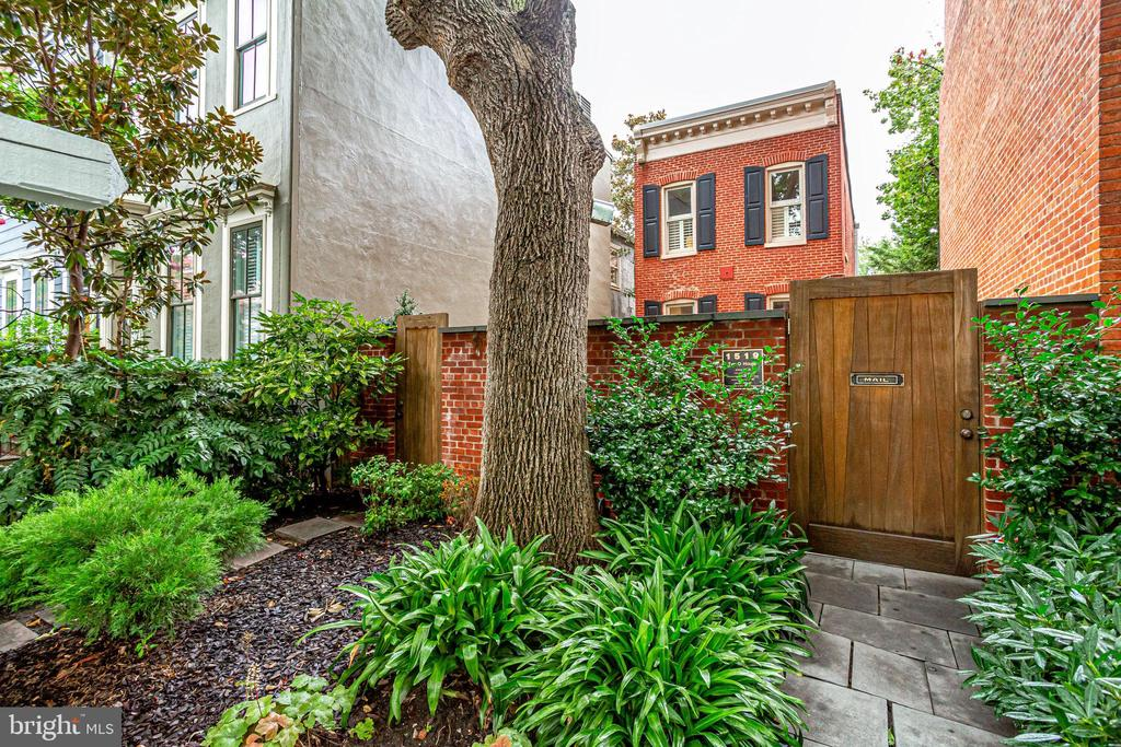 """HUGE PRICE REDUCTION - 100K.  Experience a piece of Dupont Circle and DC history every day.   Become the envy of the block as the new owner of The """"O"""" House. You may pass by this home every day and not even notice its presence. This was the first major brick structure on the block and one of the few detached residents in the Dupont area.  Set back from the street with a landscaped front yard and gated entrance, prepare to be amazed as you enter the amazing lighted courtyard and feast your eyes on the Southern Charm of this well renowned home.   This two-level detached circa 1879 home has been modified to meet the busy lives of today?s culture. The gourmet kitchen will impress the most seasoned chef with commercial grade stainless steel appliances. Abundant counter and cabinet space. The open floor plan is perfect for entertaining.  Imagine the Holiday parties you can host in this exquisite setting. The living/sitting room features a wall of built-ins, a gas fireplace with marble surround and views of the courtyard. On the upper level you will find two well-appointed bedrooms and a sitting room or home office just off the owner?s suite which offers 12-foot ceilings and 9-foot windows.   This prime location comes with two car parking in the rear, just one block to Whole Foods, CVS, and VIDA along with nightlight and fine and casual dining. A few minutes to DuPont Metro.  A rare opportunity awaits.... don't let this chance pass you by."""