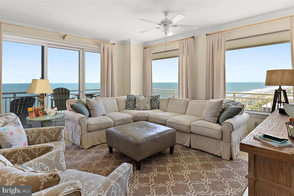 Enjoy unparalleled and breathtaking panoramic views of the Atlantic Ocean, Downtown Ocean City, and the Assawoman Bay, all from the privacy of your own direct oceanfront 4BR end unit, located in Ocean City's most luxurious oceanfront building - The Gateway Grand.   Featuring over 2200 square feet of indoor living space and 426 square feet of outdoor living space divided over 2 separate balconies, this professionally designed residence offers the best of beach living.  Step into the living area of this open-concept floorplan, where you'll be surrounded by windows, sliders, and views of Ocean City like you've never experienced before.   This oceanfront south-end-corner location means that every bedroom has views, views and more views!    Upgrades include custom millwork, kitchen tile backsplash, designer furnishings, and professionally designed window treatments.  Ground-floor deeded storage locker #11 conveys with the sale.  The Gateway Grand offers owners and guests year-round amenities that include an oceanfront indoor pool, fitness center, outdoor pool, private sundeck, a game room, deeded storage lockers, on-site property management, secured access, owners lounges, grand lobby, security, gated parking garage, and so much more.    If you're looking for the best of Ocean City, look no further.    Schedule your private showing today.