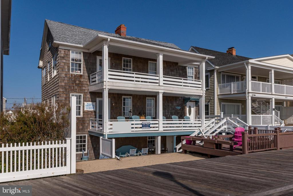 Investor Alert! Located on Ocean City, Maryland's world-famous boardwalk, this spacious oceanfront apartment building holds endless opportunities. This 6000 sq. ft. building and 7100 sq. ft. lot features five separate apartments and 8 parking spaces making it an ideal opportunity or rental investment or reconstruction. The 3-story property includes a total of 15 bedrooms, 8 bathrooms, 5 kitchens, and oversized oceanfront porches with picturesque ocean views. Each unit is unique, incorporating hardwood floors, grand fireplaces, remodeled bathrooms, and updated kitchens. There are 2 oceanfront, 4 bedroom/2 bath units with expansive great rooms and dining rooms. 1 street level 4 bedroom/2 bath walkout with a private patio. 1 2 bedroom/1 bath street level and a 1-bedroom carriage house. The property boasts a rich rental history with potential gross income of $ $289.471 per year making this an excellent investment opportunity.  The second season rental income potential allows for a year-round income stream. Over $150,000 in renovation upgrades have been done in the past 7 years making it turnkey business ready the day of settlement. The 11-year-old roof offers defense against winds up to 140mps. Indulge in a piece of Ocean City's history or redevelop to suit your needs. Call to make an appointment today before you miss out on this amazing opportunity!