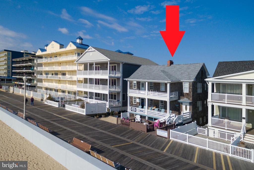 Investor Alert! Located on Ocean City, Maryland's world-famous boardwalk, this spacious oceanfront apartment building holds endless opportunities. This 6000 sq. ft. building and 7100 sq. ft. lot features five separate apartments and 8 parking spaces making it an ideal opportunity or rental investment or reconstruction. The 3-story property includes a total of 15 bedrooms, 8 bathrooms, 5 kitchens, and oversized oceanfront porches with picturesque ocean views. Each unit is unique, incorporating hardwood floors, grand fireplaces, remodeled bathrooms, and updated kitchens. There are 2 oceanfront, 4 bedroom/2 bath units with expansive great rooms and dining rooms. 1 street level 4 bedroom/2 bath walkout with a private patio. 1 2 bedroom/1 bath street level and a 1-bedroom carriage house. The property boasts a rich rental history with potential gross income of $ $289,471 per year making this an excellent investment opportunity.  The second season rental income potential allows for a year-round income stream. Over $150,000 in renovation upgrades have been done in the past 7 years making it turnkey business ready the day of settlement. The 11-year-old roof offers defense against winds up to 140mps. Indulge in a piece of Ocean City's history or redevelop to suit your needs.
