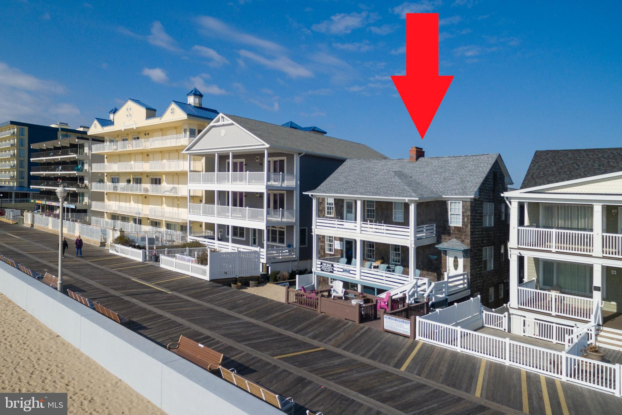 Investor Alert! Located on Ocean City, Maryland's world-famous boardwalk, this spacious oceanfront apartment building holds endless opportunities. This 6000 sq. ft. building and 7100 sq. ft. lot features five separate apartments and 8 parking spaces making it an ideal opportunity or rental investment or reconstruction. The 3-story property includes a total of 15 bedrooms, 8 bathrooms, 5 kitchens, and oversized oceanfront porches with picturesque ocean views. Each unit is unique, incorporating hardwood floors, grand fireplaces, remodeled bathrooms, and updated kitchens. There are 2 oceanfront, 4 bedroom/2 bath units with expansive great rooms and dining rooms. 1 street level 4 bedroom/2 bath walkout with a private patio. 1 2 bedroom/1 bath street level and a 1-bedroom carriage house. The property has excellent rental potential. The second season rental income potential allows for a year-round income stream. Over $150,000 in renovation upgrades have been done in the past 7 years making it turnkey business ready the day of settlement. The 11-year-old roof offers defense against winds up to 140mps. Indulge in a piece of Ocean City's history or redevelop to suit your needs.