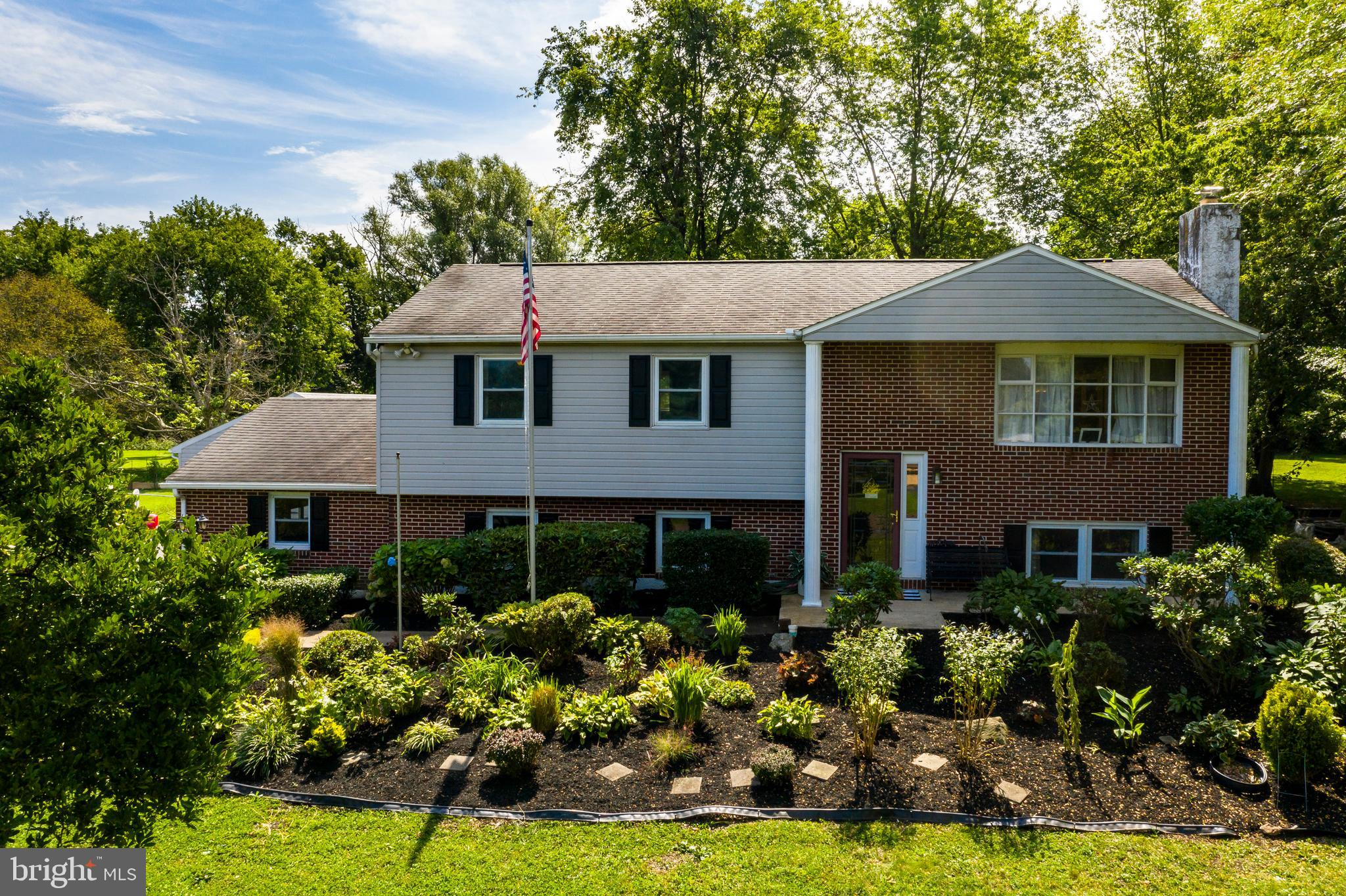 Charming, spacious 4 bed 2.5 bath home on a picturesque one acre lot in Owen J Roberts school district. Complete with an oversized 2-car garage, a generous detached garage with office, as well as a large shed to please the hobby enthusiast and exceed your storage needs.  Main floor living spaces and bedrooms boast hardwood flooring.  Kitchen has been renovated to include granite countertops, marble tile backsplash, soft-close cabinetry, undermount SS sink, and recessed lighting.  A picture window with a granite counter for bar stool seating completes the kitchen and provides an open layout for entertaining in the dining and living rooms.  Bathrooms on this floor have also been updated and include luxury vinyl tile flooring.  The lower level family room features a brick wood-burning fireplace, newly installed built-in cabinetry and shelving perfect for decorative office space and storage; you'll also find a separate laundry room here.  A new A/C was just installed in spring 2020.  As if this wasn't enough, add a large flat backyard, beautiful backdrop of trees, mature landscaping with annual flower garden, and a large newly-built deck and covered patio perfect for outdoor entertaining-- the ideal outdoor oasis!  Hurry, this home won't last long!