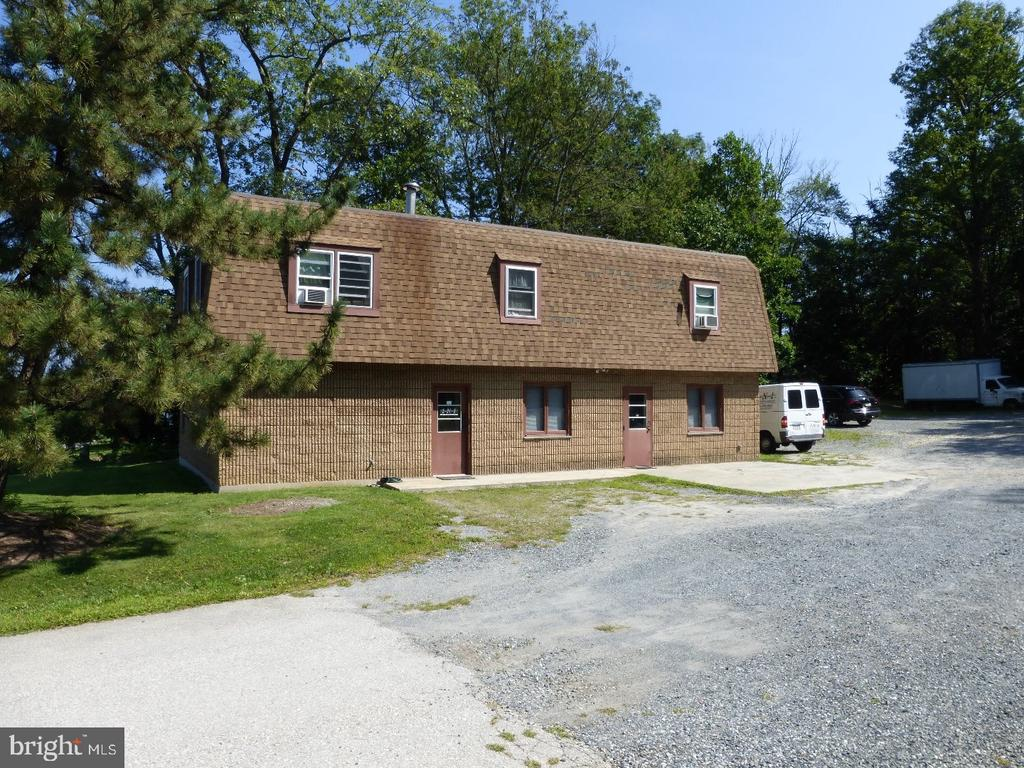 Development or investment opportunity: 5.3 +/- acres, zoned commercial.  Over 300 feet of frontage on route #100 in the busy Ludwigs Corner area.  Two story 3,000 square foot building. First floor has two office suites, second floor has two one bedroom apartments currently leased - apartment #1 at $1,050 per month and apartment #2 at $750 per month.  Plenty of opportunity here; keep as an office and apartments or develop it.  Zoning allows for many different uses including, Apartments, Church, Clothing, Commercial, Convenience Store, Day Care, Development, Financial, Florist/Nursery, Food & Beverage, Medical/Dental, Mini-Storage, Office, Professional Service, Retail or School.  Join the booming Ludwigs Corner area.