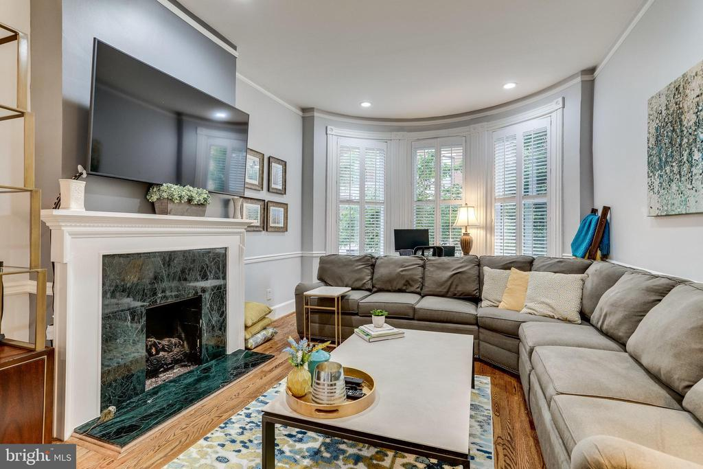 """**OPEN SUNDAY OCTOBER 4TH, 1:00-3:00 PM**  Welcome home! Extraordinary - and extraordinarily spacious -  2 bedroom, 2.5 bath condo (2002 Sq Ft as per appraisal) with Parking and Two Private Outdoor Spaces on one of Dupont Circle's QUIETEST, most coveted streets.  SO peaceful, yet steps from all the action. """"Bedrooms down"""" layout features two king-sized bedrooms with full bathrooms en suite.   Primary/Owner's Suite with sitting area, luxurious bath with jetted tub, separate shower, Custom walk in closet and built ins.  High-hat lighting throughout.  Large Second/Guest Bedroom with SGD leading to private outdoor courtyard/Patio that also offers a bonus storage closet. A laundry closet rounds out the entry level. Upstairs you'll find 10 foot+  ceilings accentuating an incredibly  bright and airy space with a formal living room, parlor w/bar area, dining room and a SUNNY kitchen. Special touches include: wood floors, 2 gas fireplaces, distinctive molding throughout, Gorgeous Built-Ins, a main level powder room and 2 bump out bays. The LR also boasts plantation shutters and double pocket doors. The kitchen features SS appliances, Silestone counter tops, an external exhaust fan for the """"serious cook"""",  all adjoining an outdoor deck/BBQ area.  Off street parking in the alley known for the """"Jackson Elm"""", a legacy from the period the former President owned the property next door. Across the street from the Ross Elementary School.  Walking distance to Adams Morgan, Downtown, 14th Street, Logan Circle, West End, Georgetown and crawling distance from 17th St.  Incredible value for the amount of space in such a superb location!  Must see."""