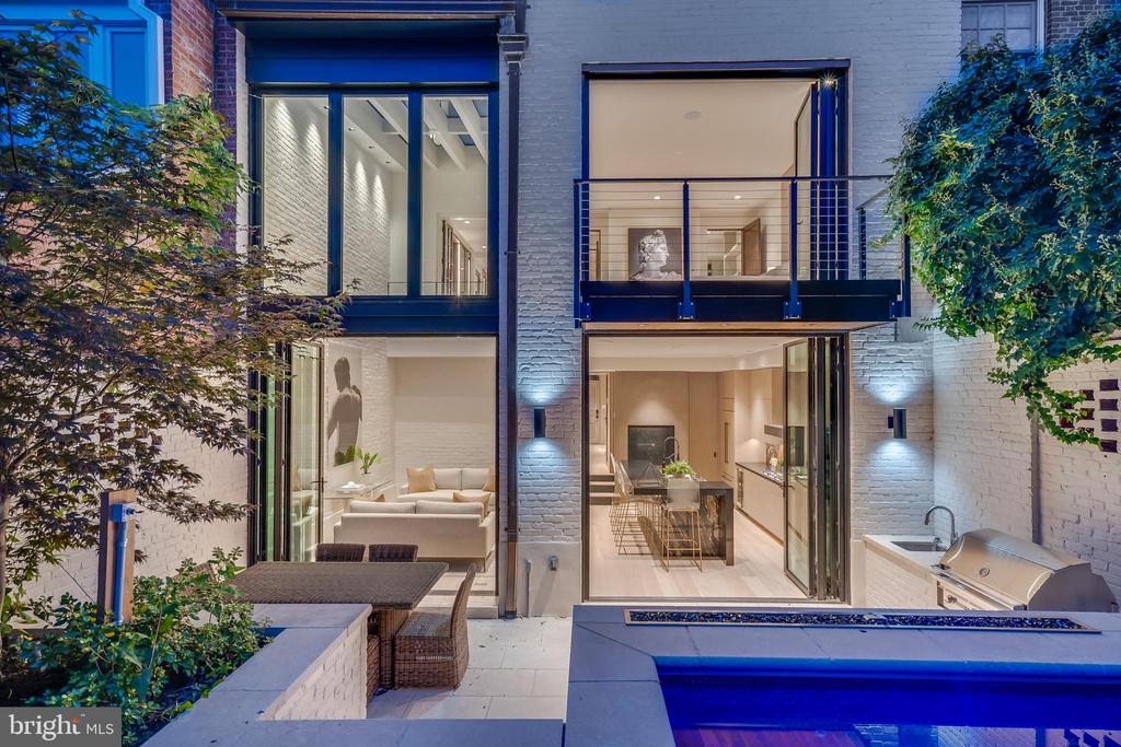 This beautiful row home in is the definition of modern elegance. A $2,000,000 remodel from top to bottom including the addition of an elevator, pool/spa, fire feature and more. Entering from the attached garage, the main level includes a sophisticated kitchen and living space with Miele appliances and two sets of accordion doors that creates a seamless flow to the back patio grill and dining which is complimented by a heated pool and spa.  The master bedroom spans the entire second floor and includes a fireplace, oversized closet, large master bath with heated floors and towel rack, spacious shower, TOTO bidet toilet and soaking tub. Spacious secondary bedrooms with on suite baths that included seamless glass and tasteful finishes. The top floor includes a half bath and lounge area with extra storage and two, top of the line, mini refrigerators as well as deck access with expansive views.