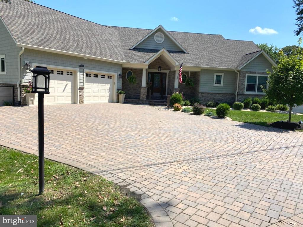 Waterfront Living at its best in this pristine residence with the finest finishes & upgrades  & thoughtful design to maximize square footage & water features, The exterior offers a paver driveway & inviting entry to an Open floor plan with Great Rm w/stacked stone  fireplace  & built-in wet bar overlooking a newly designed Sun Room with windows & views  of the Magothy River! Walk out of the great room into  the Gourmet kitchen with all the upgrades including Granite counters, Center island & Breakfast Rm  only steps from your private office which lends for your work at home convenience,  Enjoy more waterviews in your Master Suite with upscale luxury bath with walk-in shower & tile design,  Additional bedroom with private bath & 1st floor laundry,  Lower level offers a 2nd kitchen for your entertaining needs or a perfect in-law suite,  Two  additional bedrooms with 2 full baths and recreation areas,  Step out onto the specially designed patio & a lifestyle on the water with an outside kitchen with grill & refrigerator,  1/2 bath & hot tub~ Overlooking the water is  a Gazebo & only steps from the 40 ft Pier with electric, 2 boat lifts & a jet ski lift, This is is truly a turn key property ready for the new owner to enjoy!  More Photo's available  Thurs, 9-10th