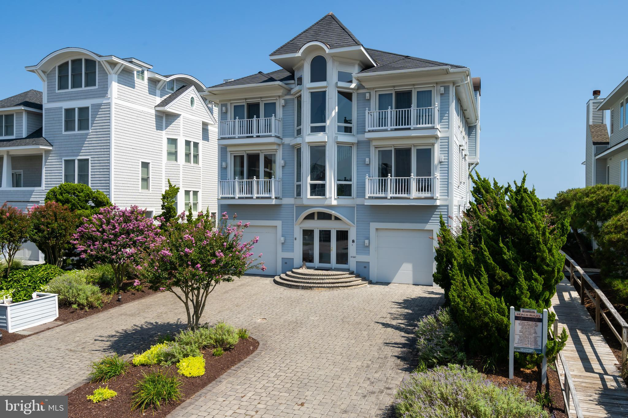 New price for an impeccable oceanfront home in Seabreak!  The care and planning that went into the design and construction of this residence is evident from the moment you enter the paved curved driveway and are greeted by the carved wooden staircase within the entreway.  The feeling of spaciousness and light is throughout the home, with 9' ceilings on the main floor, 8' on the ground floor, and vaulted ceilings on the third floor.  The abundance of windows throughout allows the panoramic ocean views to be seen from almost every angle of the living space. There is ample room for family and friends, with 5 spacious bedrooms, 6 full baths, and one half bath.  An additional room, with locking closet and its own balconey, could also be used as an additional bedroom. There are two large suites on the third floor, each with its own oceanfront deck, fireplace, and full baths.  This is especially beneficial if there is co-ownership of the home. An additional room on the ground floor, which is currently being used as a game/rec room, would also be a good sized bedroom, with an adjacent full bath.  Two complete laundry rooms, one located on the ground floor where beach access is, the second on the main floor, provide easy workspace for those necessary tasks that  come with beach enjoyment. The living, dining, and kitchen areas are open and take full advantage of that ocean view the home was designed around.  There is almost unlimited space for entertaining, and enjoying the company of friends and family.  Once you step outside, the grand deck, with tempered safety glass railings so as not to impede the view, beckons you to sit, relax, and enjoy a drink while taking in the vista that makes this home so captivating. The home is being sold fully furnished, ready for the new owners to enjoy. In addition to the abundant special features of this home, the community of Seabreak offers guarded beaches during the season, tennis, and is an easy walk or bike ride to the town of Bethany 