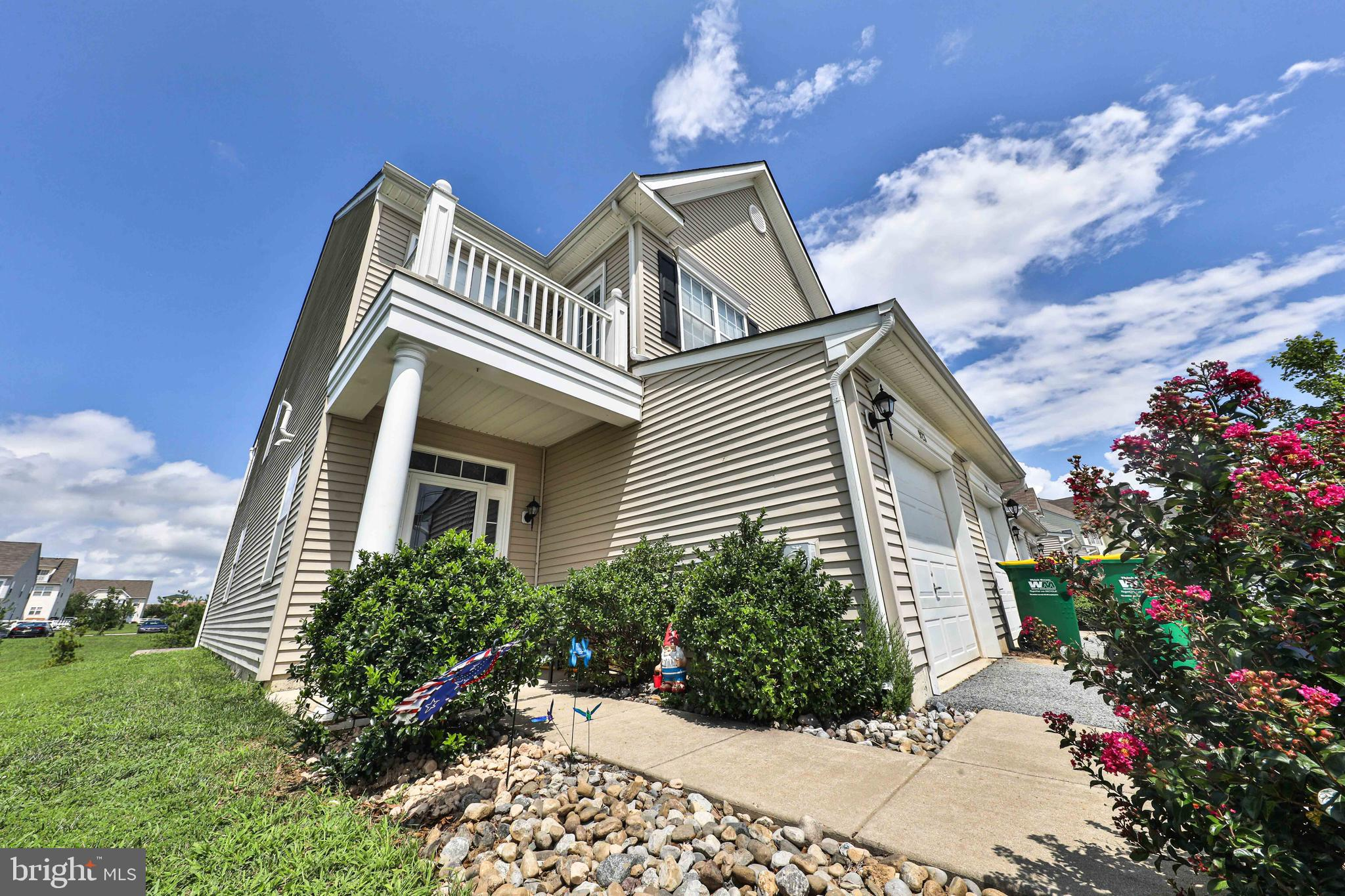 BACK ON THE MARKET! This stunning end unit townhouse shows like a model home located on one of the best lots in the neighborhood! The gleaming hardwood floors greet you as you enter the bright foyer and continue into the impressive open floor plan of the first floor. Enjoy entertaining with family and friends in the large living room, eat-in-kitchen with sun room and patio off of the sliding glass doors.  Endless cabinets and counter space are featured in the well-designed kitchen. The master suite includes the upgraded balcony overlooking the breathtaking community pond. There is also a private full master bathroom with dual sinks and convenient second floor laundry room. Notice the upgraded flooring, railing and spindles along the second floor hallway as you explore the additional two bedrooms and full hall bathroom perfect for out-of-town guests. Sure to please the most stylish buyers are the custom neutral colors throughout this home. The conveniences of a pharmacy, Christiana Care facility, police station, WaWa gas station, restaurants, grocery store and more are all within walking distance along with access to Route 1 for an easy commute. This property is truly move-in ready and awaits the new homeowner to move in and enjoy!