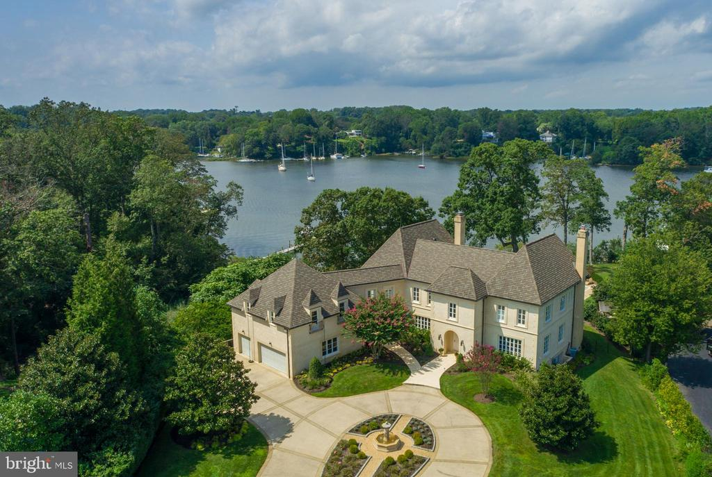 "This Grand French Manor, curated with imported materials from Bourdeaux, stands proudly on the banks of the Severn River just minutes away from downtown Annapolis and the Chesapeake Bay.  Deceptively ample in scale, and tucked away on a quiet dead-end street in the premier residential enclave of Wardour, one of Annapolis' most sought-after neighborhoods.  This trophy home is in a league of its own, achieving unparalleled scale and quality which seamlessly merges into the backdrop of an already exceptionally rare 1.6-acre expanse with 185' of private water frontage. Beyond the gates sits a circular arrival court with a beautiful central fountain and three-car garage. With unsurpassed attention to architectural details, this magnificent home welcomes guests to a sun-drenched foyer with soaring ceilings centered by breathtaking views of Weems Creek and the waterside pool area.  Spanning 10,000 square feet with seven bedrooms, five full baths, and two half baths - the newly updated interior includes dramatic entertaining areas, complete with three fireplaces, 700 bottle wine cellar and stunning water views from almost every room.  Interior design inspired by former Ralph Lauren stylist, Isaac Mizrahi, Calvin Klein, and Donna Karan designers.  The exquisite NEW chef style kitchen is appointed with ""Waterworks"" ultra-premium cabinetry and hardware, massive center island and commercial grade appliances.  The covered terrace which overlooks the NEW 25' x 50' pool and in-ground hot tub is the perfect place for al fresco dining while enjoying glorious sunset views. This extraordinary residence is surrounded by classic gardens with paved areas ideal for outdoor living and entertaining.  Strategically placed landscape lighting illuminates the double gated entry, circular drive, sparkling fountain and waterside lounge area, setting an impressive stage for the elegance within. The deep-water dock (8ft water depth) is equipped with a 40,000 boat lift, dingy lift and a floating pier, perfect for the boating enthusiast plus the Weems Creek setting provides quick access by boat to the Annapolis Harbor and the Chesapeake Bay.  Conveniently located to access Downtown Annapolis, head over the Bay Bridge to the Eastern shore or jump on Rt. 50 to get back to Washington, DC and just a few short blocks to West Annapolis' charming commercial district's restaurants & shops.  This true ""Legacy"" property offers the complete package: privacy, convenience, security, beauty and comfort.  To explore the property without leaving your home, be sure to view the HD Video Tour: https://youtu.be/vUs31sMXPQU"