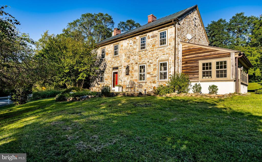 Located down a quiet gravel lane, get ready for this Historic Colonial Stone Farmhouse built in 1764- 41 Saint Andrews Lane a historic home is updated for a luxury living experience. A spacious updated 2,780sq/ft, 3-Bedroom, 2.5 Bath main home located on a sprawling 4.1 acres complete with a renovated barn for events and gatherings, hobbies/sports, and a two office building is perfect for work from home and the ultimate of gracious living! The barn features 2 newly built bathrooms and an oversized yoga studio with stunning hardwood floors you can use for just about anything-perhaps your private basketball court or your woodworking venture?     The attention to detail in renovating this home is seen throughout and brings history and luxury together; the work-home office is a testimony to that. Complete with its own entrance, waiting room area, and bathroom you'll never have to leave your new sanctuary as you can work and play right from home.    The eat-in kitchen is a gorgeous farm style kitchen with vintage brick floors and glass front cabinets. A large farm style sink sits below a great window that looks out on to your amazing estate grounds. The kitchen features an island with seating for 4 and plenty of room for prep work. Take in the abundance of light in the dining area perfect for a nice large table that's sure to see many Thanksgiving dinners and moreover the years.     The home also includes 2 large fireplaces with wood-burning stoves to enjoy those cold winter days as you settle in with a good book. The master bedroom features a large walk-in closet and vintage wide-plank hardwood floors. The master bath has a stand-alone deep soaking tub and glass-enclosed shower creating the perfect pampered atmosphere.     Two additional bedrooms with fireplaces assure you, your family, and your guests to feel comfortable and cozy. Plenty of room for everyone to spread out and enjoy your new luxury Colonial Farmhouse!    The grounds are just as luxurious with expansive manicured lawns and an amazing water pond with a trickling stream and a meditation labyrinth. Gardens galore surround the brick patio and be sure to take a walk through the swath of grassy area to a private retreat with a fire pit. Massive trees framing your property would have you believe you are living in the middle of the forest however you are so close to great shopping and all the major routes you can really have it all here... secluded acreage just a stone throws away from all the action; located in the desirable O and J School District yet easy access to local trains and the airport to Philadelphia and NYC. Your new home is just waiting for you... it's time to make this piece of history yours!