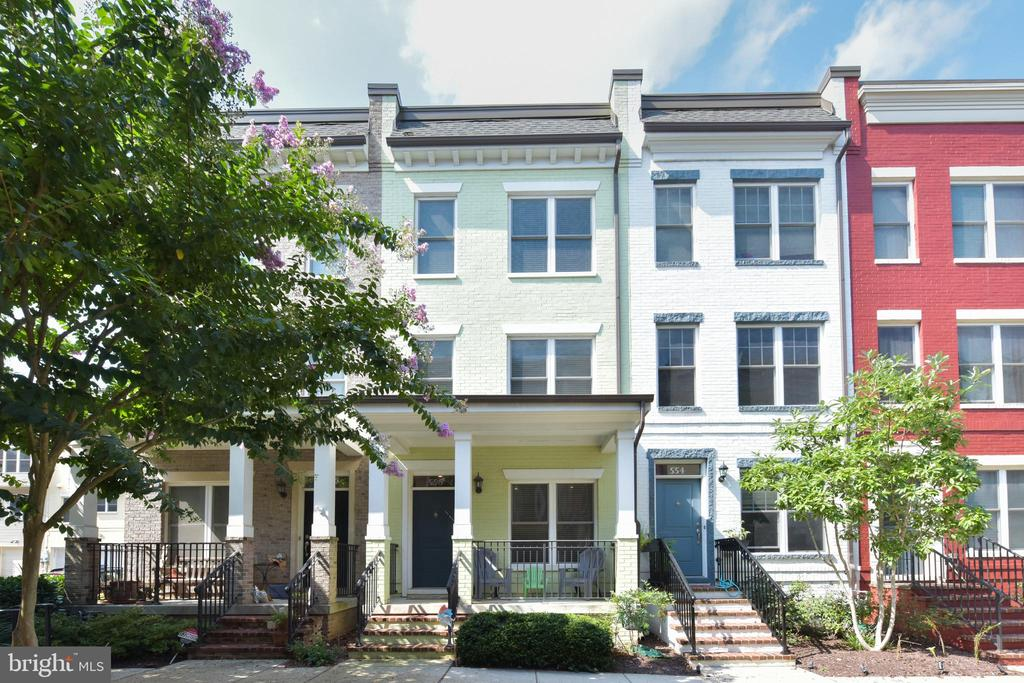 Open House SUN 9/13  1-3pm   556 Regent Place is a gorgeous 3 BD, 3.5 BA + home office + loft Federal-style townhome in EYA's famed Chancellor's Row. This friendly community with vast open green space and two playgrounds is such a reprieve from the hustle and bustle of the city.   Built in 2011, this home has ample space to live, work, and entertain across 4 spacious levels. Walking in you will see gleaming hardwood floors, an office for all your work from home needs and an attached one-car garage with ample storage space. On the 2nd level you will find a gourmet chef's kitchen with granite countertops, stainless steel appliances and balcony with gas line for grilling. The open floor plan continues into the sunny dining and living room, complete with a convenient half bath.   The third level's owner suite and second bedroom are spacious with large closets and en-suite bathrooms, and a stacked LG washer/dryer in the hallway closet.  On the top level, a third bedroom with yet another en-suite bathroom awaits, along with a spacious and sunny loft, perfect for a playroom or 2nd home office/study. And you will have ample space to entertain with your own private roof deck with a stunning view of the Basilica!  Owners have meticulously maintained the home, replacing both HVAC/heat systems (with UV filter in upstairs unit), water heater, dishwasher and washer/dryer.  Upgrades include custom wood blinds, kitchen tile backsplash, custom glass shower door in master bath and new ceiling fans.  To get you ready for life in Chancellor's Row, owners will convey gas grill, roof deck furniture and custom ELFA office system.   556 Regent Place is just 5 Blocks from the Monroe Street Market and Brookland Metro Station.  Be prepared to enjoy everything Brookland has to offer, including local restaurants, farmers market, and easy access to the Metropolitan Branch Trail.