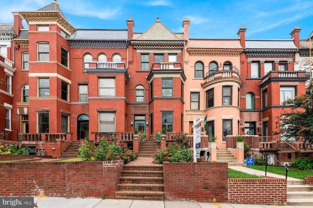 OPEN HOUSE Sunday 10/04 --1:00-3:00 pm.  Call 301-807-1080 for viewing appt. Must See in Bloomingdale with separate (C of O) income unit --- Beautifully Renovated four level Grande Dame  -- 2307 1st Street Welcomes you Home with Carrara marble tile entry, exposed brick walls and open Living Room featuring Gas Fireplace and Bay Window.  Step through the Dining Room including a wine closet and  flow into The Gourmet Kitchen - featuring Calacatta Quartz,  Professional Appliances w. Range Hood & Restoration Hardware Fixtures.  Gorgeous full wall height cabinetry and storage spaces on all of the Kitchen walls.  Entertain on your brand new TREX - composite Deck - perfect for Al-Fresco Dining and Entertainment.  New Wide-plank Oak hardwood flooring throughout the home.  The upstairs  level features two spacious Bedrooms, second Fireplace and simply Fabulous hall Bathroom - Timeless polished Marble tile work  + Restoration Hardware Fixtures and ToTo commode.  The bright fourth floor includes bedroom three with Juliet Balcony and en-suite Bathroom.  2307 1st Street provides fantastic private outdoor entertaining spaces between the NEW Main level Deck + Fabulous Rooftop Deck - one of the highest points in Bloomingdale - rarely found and truly coveted views of DC.  You must see yourself! The lower level includes completely separate 2 bedroom, 1 Bathroom (with C of O!) unit presently generating $2250/month.  Attached Garage Parking completes the picture.  Visit the 3D Model:  http://spws.homevisit.com/hvid/308235  --- Contact Agent to arrange Private Tour.