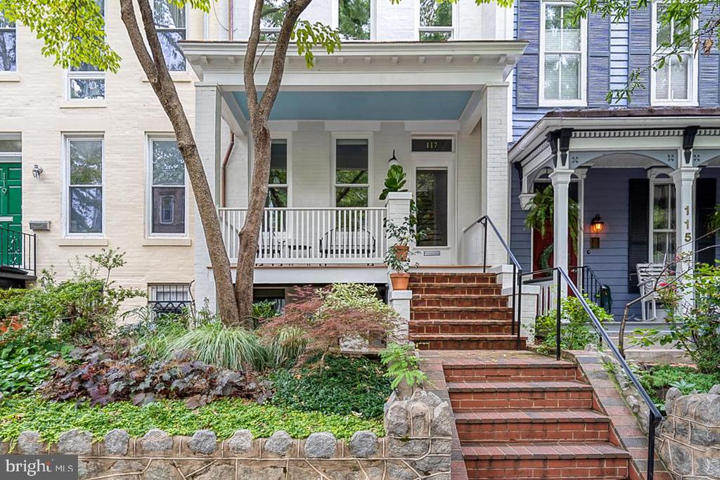 This exquisite Capitol Hill row house, mere steps from the Supreme Court, shouldn't be missed. From the moment you walk through the front door, it's clear that every detail and finish has been thoughtfully considered, resulting in a beautifully curated home that will appeal to a buyer with an affinity for style, design and excellence. The main floor features an open and inviting living space, dining area, half bath and top of the line kitchen in the rear of the home complete with a Viking Range, white subway tile backsplash juxtaposed against stunning black honed granite countertops, with barstool dining nook. Contemporary light fixtures throughout meld effortlessly with classic Capitol Hill charm (including the original front door, newel post and fireplace mantel). The kitchen opens to a lovely lower deck overlooking a completely remodeled courtyard with flagstone patio and professional landscaping featuring native plants.  Gate opens to coveted two-car off-street parking. The lower level features one of four bedrooms, custom wet bar, and large living room. This versatile bonus living space can serve a variety of different needs, especially during this era of Covid when so much of daily life (work, school etc.) is centered in the home. The upper level features original pine floors and a bright and airy master bedroom with vaulted ceilings and an exquisite all marble, master bath. Two additional bedrooms round out the second floor, including a recently remodeled bedroom with eye-catching exposed brick opening to a delightful second story covered porch with new pine beadboard ceiling. Elfa closet systems throughout allow for ample storage. This gem is move-in ready.  Don't delay!!...  Click here for a Virtual Tour - http://spws.homevisit.com/mls/308245
