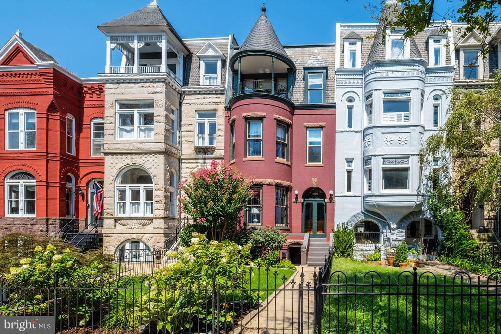 Beautifully, thoughtfully, and lovingly restored 4BR/3.5BA home w/ separate lower level 1BR/1BA apt. (with C of O) boasting original details & high-end finishes! Gleaming pine HWFs & floods of natural light throughout the home. Formal LR w/ gas FP, 10' celings, turret bay windows. Formal DR off gourmet kit featuring, Professional SS-appli., including 5-burner gas cooking & range hood, custom cabinetry, ample cabinet space & a screened-in porch. Owner BR fts. 9' ceilings, sleeping cove, walk-in closet & luxury en-suite bathroom. Top level of home in BR 4/family room fts charming covered balcony w/ panoramic city views. Lower level offers separate, legal one-BR apt. with updated bath, full kitchen & LR. This home is a rare beauty and unique opportunity that cannot be missed. A stone's throw from lovely Lincoln Park, and walkable to fine dining, daily errands, METRO/Amtrak, Eastern Market, Barrack's Row, Union Market.