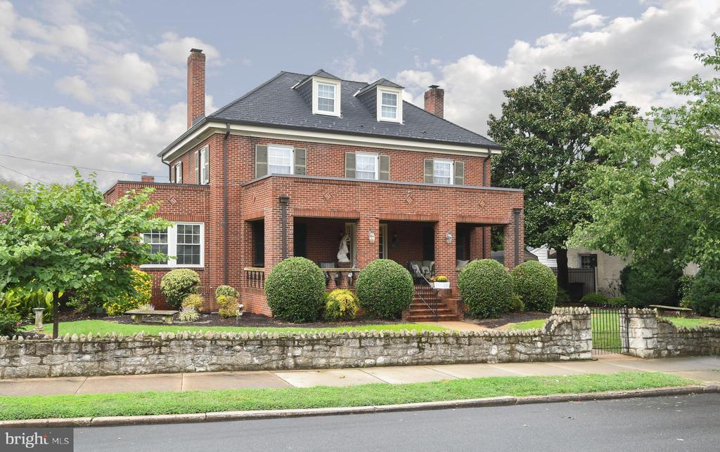 All brick Colonial in downtown Fredericksburg.  What a unique offering:  Personal residence with a separate guest or potential rental property on 2 city lots.  Hanover has  hardwood floors,  chair railing & crown molding  throughout most of the interior.  A remodeled Kitchen with  ceramic floors, SS appliances, Wolfe Maple cabinets and granite countertops with backsplash & tray ceiling, recessed lights & walk-in pantry.  A quaint breakfast nook to enjoy off the rear corner.  The living room features include  a brick wood-burning fireplace with a walk through to the sun room with free-standing gas fireplace.  Most of the bedrooms have hardwood flooring.  The primary BR has an oversized walk-in closet, luxury  bath suite with a  corner soaking tub.  The second upper level has a 4th bedroom with separate kitchenette (sink & mini-fridge) & full bath.    The exterior features include:  Vinyl windows (approx. 10 years old),  Royal Synthetic Slate roof with extensive warranty (approx. 8 years old),  Copper gutters/downspouts, HVAC approx 3 years old,  and an rrigation system in the  front yard with exterior lighting.  Second property @ 803 Littlepage St. has 2  bedrooms and 2 full bathrooms.  Great room with a gas fireplace.  Primary bedroom has tray ceiling, 2 walk-in closets.  Kitchen with cathedral ceiling, skylight. & hardwood floors.