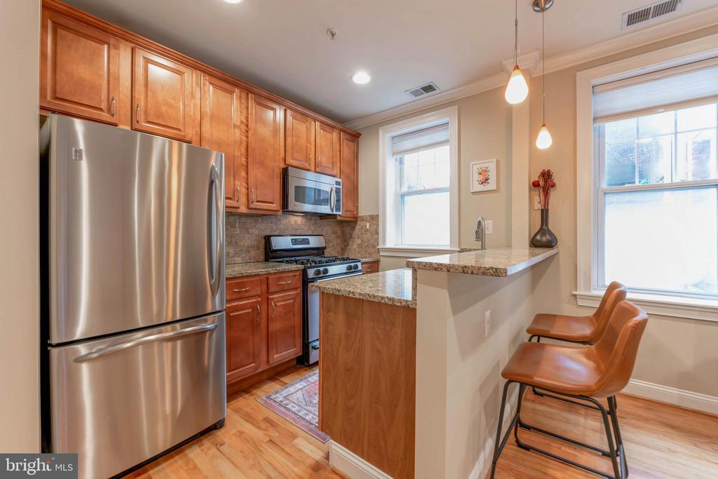 **$9,500 CLOSING CREDIT offered by seller!**  Why rent when your all-in monthly payments could be as low as $1900/mo including taxes and condo fees with 0% down?  This boutique Bloomingdale 1 bedroom condo has it all - it's open concept, has an in-unit washer/dryer, is *well above grade* on the quiet back of the building, and it allows pets and investors and is VA approved!  Where else in the city can you find great updates to complete the package - the open kitchen has a granite breakfast bar and all stainless appliances, including gas range and dishwasher - perfect for entertaining!  The modern bathroom is also accessible from the hallway and includes a deep soaking jetted tub.  Stepping outside, the Shaw metro is ¾ mile away and the new Whole Foods is just a mile away. Drinking and dining options abound - Boundary Stone, The Red Hen, and Bacio Pizzeria are only two blocks away, with Big Bear Cafe and the farmers' market just 5 blocks south.  And if you (or Fido) are looking for that perfect quiet and green DC park, Crispus Attucks is literally around the corner.  What more could you want?  Come, enjoy and rest easy - you're home!