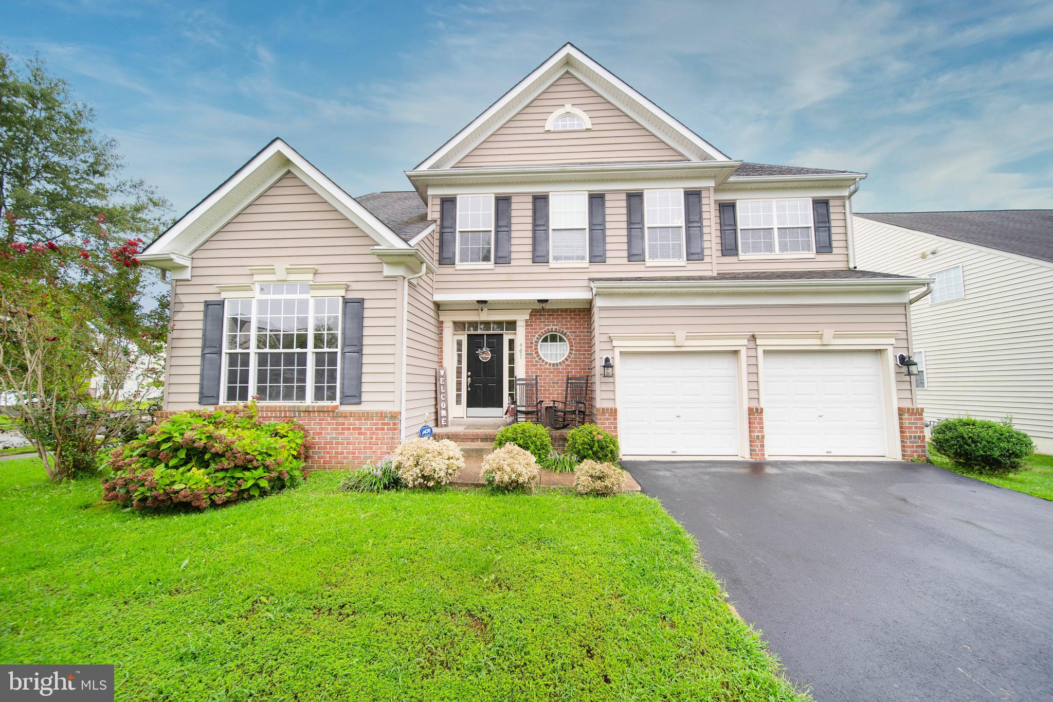 """Welcome to 134 Gloucester Blvd in the highly sought out neighborhood of Willow Grove Mill, within the Appoquinimink School District! Willow Grove Mill is conveniently located near DE 1 and 13, and minutes away from shopping, restaurants, and gas stations. This four bedroom, two and a half bath home is on a beautiful corner lot, and has a fully vinyl fenced yard (with a view of the community pond). This home has great curb appeal, with the brick water table and black shutters. Upon entrance, you will love the two story foyer, with a turned staircase, and an open feel! Most of the main level consists of hardwood flooring, and brand NEW carpet! Just to the left of the entrance, there is a large office with French doors, and to the right is the half bath. The kitchen is the perfect size, with an abundance of 42"""" cabinetry, a kitchen island, pantry, and a seating area that is perfect for a smaller breakfast table. You can access the backyard from the glass slider in the kitchen. You will LOVE the deck, with the large fenced in yard, and view of the pond!  The family room has a gas fireplace and mantel, perfect for snuggling up on a cold night! The main level also has a living room, and a large dining room with chair railing, and crown moulding. Upstairs you will find four generous sized bedrooms, two full bathrooms, and a large laundry room. The primary bedroom is HUGE, with cathedral ceilings, a ceiling fan, and plenty of space for a large bedroom set! The primary bath has ceramic tile throughout, tiled shower, double vanity sinks, and a large walk-in closet. The hall bath also has a double vanity sink, and tile flooring. The additional three bedrooms are a great size! This home has an ample amount of windows, that fill the home with natural light! The basement is unfinished, with tons of potential. The basement also has a walk up to the backyard, and a rough in for a future full bathroom! This home has so much to offer! You couldn't ask for a friendlier neighborhood! S"""