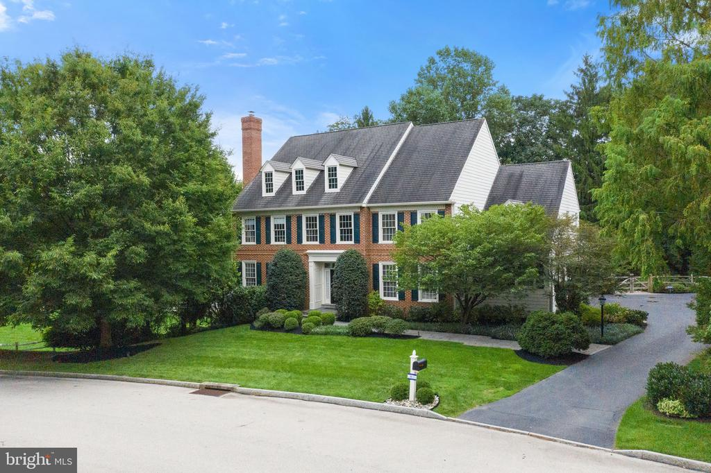 Located in the center of Philadelphia's coveted Main Line, 301 Durham Drive offers the very best of Town and Country living!  Edenton Place is a quiet enclave of only 18 homes, with a Villanova address in the center of Radnor Township, which offers award winning Radnor schools (Radnor Elementary), and ultimate convenience.   This Vaughn-built brick and Hardie siding home, combined with this sensational location, are a perfect combo for easy living.  Inside, the floorplan welcomes you with a large entry foyer and dramatic turned staircase. To the left, you will find the formal living room with fireplace, and to the right the dining room. The front hall features two coat closets for plenty of storage. As you walk to the back of the house, a formal powder room and large home office/den/study with bench window seating makes the perfect work from home space. The back of the home offers full open concept living, with an updated Chef's kitchen with cabinets to ceiling, Thermador double oven, Wolf cooktop, Sub Zero paneled refrigerator, wine fridge, large center island with plenty of seating, and breakfast area.   Just off of the kitchen is one of the best parts of this home -  the large and open covered screened in porch over azek decking. This porch acts as an extension of the living area and allows for 3 season enjoyment: because it is covered, it's always clean and ready for enjoyment. The porch provides access to the outdoor deck, great for sunning and bbq. Back inside, adjacent to the kitchen area is the great room with a cathedral ceiling, wall of windows with plantation shutters, stone hearth to the gas fireplace, and built in surround sound system. This room is the perfect spot to watch the game or to get cozy for a movie. To complete the main level,  adjacent to the kitchen, a butler's pantry for easy entertaining connects the kitchen to the dining room. The mudroom features lots of closet storage, a large laundry room, entry to the three car garage with lots of w