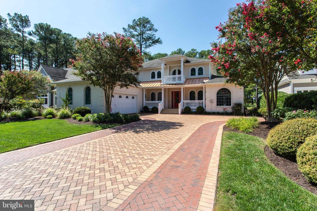 Prepare to be impressed by this custom built home, located in The Point at Ocean Pines.  Enjoy the convenience of your own private dock, already equipped with an 8k lb boat lift, perfect for current or future boat owners, or anyone who seeks easy and convenient water access to enjoy the large variety of water recreation activities.  With an easy-living floor plan, indoor heated salt water pool, top of the line finishes, whole house generator, in-home elevator, Bose surround sound system,  and more ... Incredible views out of nearly every window - your choice of  the Ocean City skyline, or nature-rich Isle of Wight Bay, where you'll enjoy the stunning evening Sunsets.   The meticulous attention to detail in this home will be noticed immediately.  First floor is designed for easy single-floor living.  Enjoy 10' ceilings, first floor primary owner's suite, gourmet kitchen equipped with top of the line Sub Zero and Electrolux appliances, and custom Amish built cabinetry not only in the kitchen, but throughout the entire home.  Step into the elevator, or take the stairs, where you will find an additional living area that is set-up for comfort and relaxation, with a fully equipped wet bar, second full W/D, 3 spacious bedrooms and 3 additional full bathrooms, and 3 exterior porches ... all with remarkable bay views.   Situated along a quiet cul-de-sac street, where you will feel removed from the hustle and bustle, and yet are just minutes away from water activities, dining, shopping, and the beaches.   What more could you want in a home?
