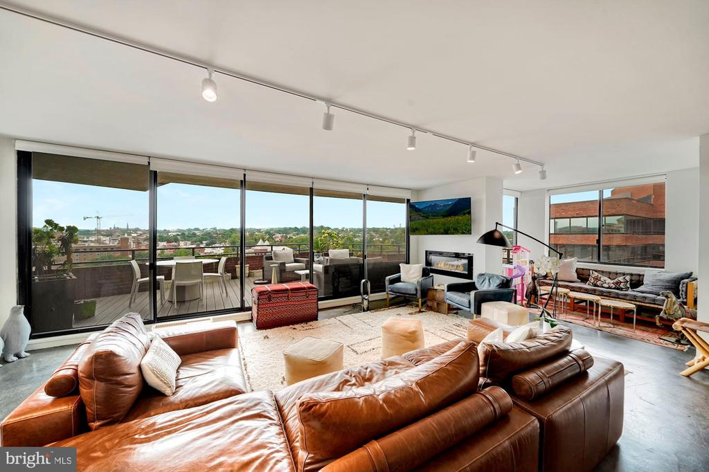 EXTRAORDINARY OFFERING - COVETED SWEEPING VIEWS from THE  POTOMAC TO THE NATIONAL CATHEDRAL . Enjoy the sunset views of Georgetown and beyond from a stunning 400 sf balcony. This dramatic 2165 sq ft unit has been totally renovated featuring two bedrooms, a den, 2.5 baths, open gourmet kitchen plus dining area.  The large den includes a wet bar, lovely cabinets and a sun filled view with balcony access. Wonderful intimate sitting  area features an electric fireplace/Four new heat pumps, concrete floors, on demand hot water, over-sized washer/dryer/and abundant storage. The master bedroom has a private second balcony , double vanity, walk-in closets and separate shower. The Westbridge offers 24 hour desk, outdoor pool, fitness center, garage parking space and extra storage.  One block to Georgetown and Trader Joe's, and close to shops, metro and restaurants. RARE OFFERING  IN A LIFETIME LOCATION- BY APPOINTMENT ONLY.