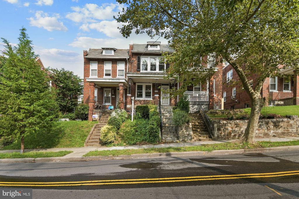 Well kept home with great features and updates, in sought after Brookland.  Just blocks to restaurants and grocery store.  Accessible to Brookland and Rhode Island Metro.  New air conditioning 2/2020 - New Windows: 11/2018 - Painted roof: 11/2018 - New chimney liner 4/2019  - Open plan kitchen/dining area: Bosch Dishwasher, Samsung Oven, LG Fridge, Industrial range hood with exterior venting, Granite kitchen counter tops - Renovated basement, full bathroom, and laundry room - Flagstone front steps - Modernized upstairs bathroom (new vanity, toilet, sink) - Samsung Washer/Dryer