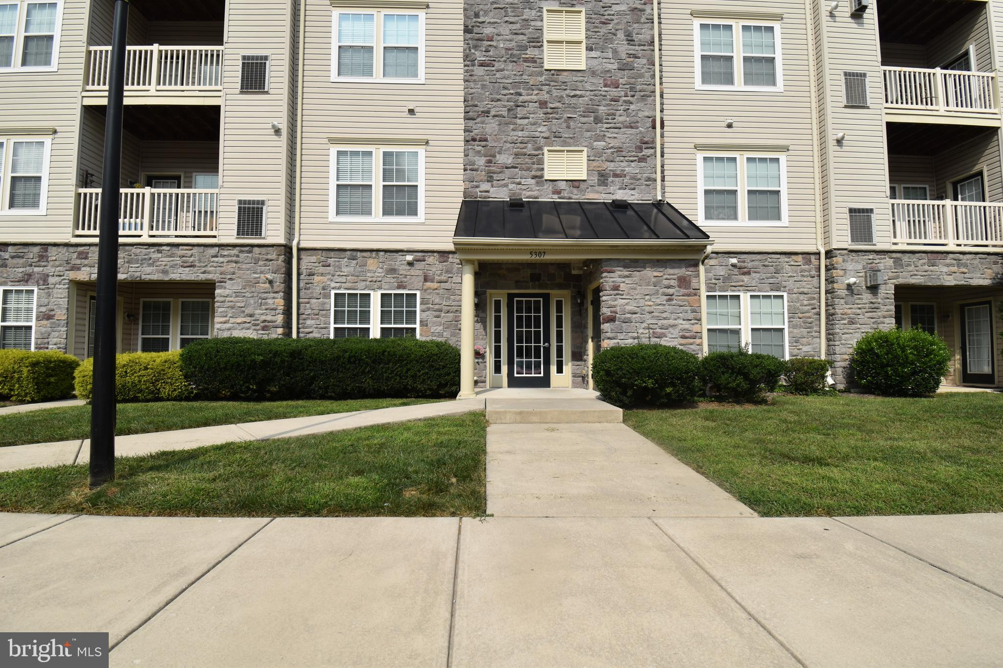 This Large Open Floor Plan Condo is Tucked Away in the Wyndholme Woods Community* Approx. 5 Minutes from Route 695. Take an Elevator Ride to your Spacious and Luxurious Third Floor Condo* It Features  a Grand Entry Foyer to your Living Room and Dining Area, Adjoined to your Walk Through kitchen with 42' Oak Cabinets, Breakfast Bar, all Stainless Steel Appliances,Laundry and Pantry*Large Master Suite with Super Bath,Double Sink, Walk-in Closet Plus Wall Closet Both with Custom California  Closet Organizer*Large Second Bedroom That Adjoins Hall bath, Could be Second Master Bedroom*Plus an Open Office or Sun room with Connecting Rear Balcony.