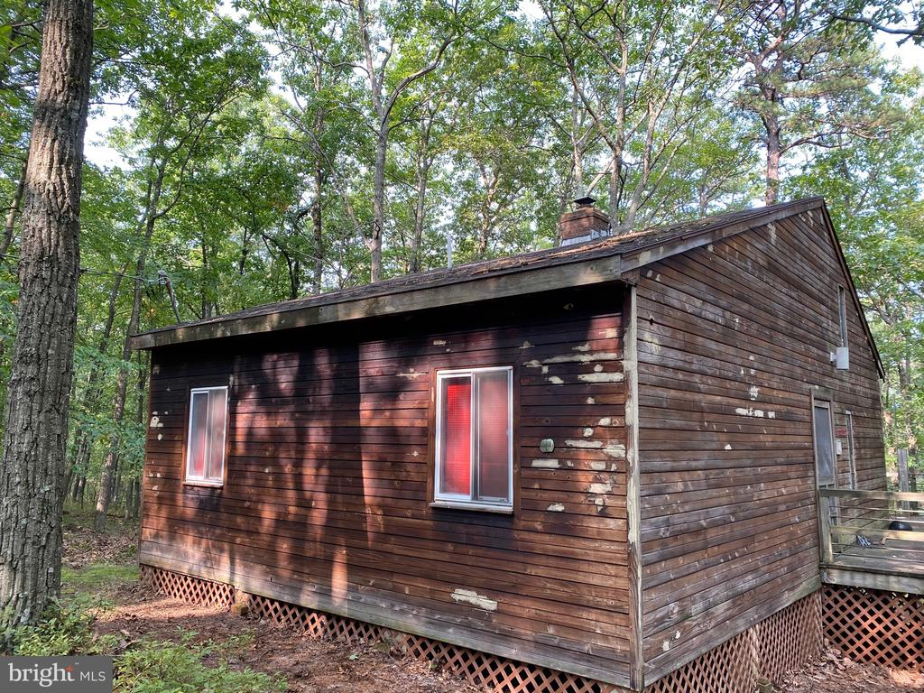 2 Lots in Cacapon Highlands with this cute cabin being sold as is.
