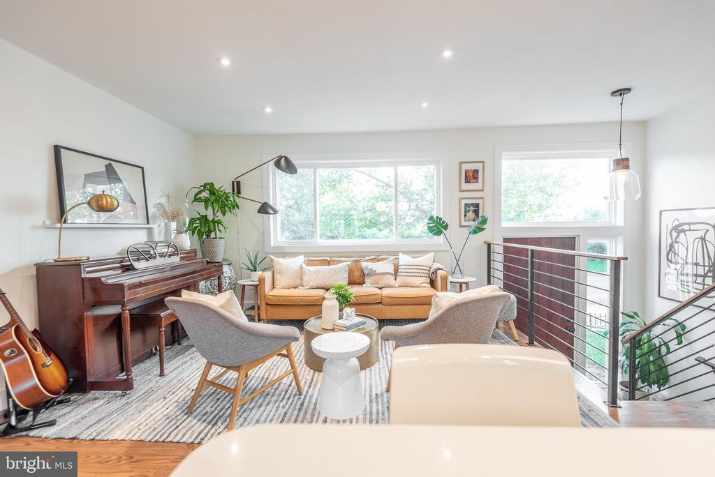 Nestled on a quaint and quiet tree-lined street, 1368 W St NE is a breathtakingly beautiful home renovated in 2018 with exquisite high-end finishes and impeccable attention to detail. This block of W St NE features Mid-Century Modern-inspired rowhomes with a line of trees on the other side of the street to give you a sense of peace and quiet in the city. Designed by the renowned Melissa Cross Interiors, this home has been meticulously and lovingly renovated with hospitality and community at top of mind. From the oversized windows that fill the entire home with magical sunlight to the custom hand-painted tile and hardwood floors throughout, this gorgeous home is matchless in its thoughtful floorplan and design, as it bursts with beauty and grace. The grand two-story foyer welcomes you to stay awhile and leads to the bright and airy living room and dining area which features custom built-in benches that double as brilliant storage compartments as well. The remarkably spacious kitchen is perfect for entertaining, gathering, and cooking with loved ones as it boasts custom shaker cabinetry, quartz countertops, and open shelving styled to perfection. Move just in time to host your Thanksgiving or Friendsgiving feast! The double doors lead to the rear deck, patio, and grassy backyard that provide ample space for hosting get-togethers or simply running around with the family. Enjoy the cool Autumn weather while grilling over the weekend and roasting s'mores over a firepit in the evenings. The upper level features three well-sized bedrooms with spacious closets and a delightfully designed bathroom with marble tile, monochromatic and geometric flooring, and bespoke finishes. The lower level offers a family room, a full bath, a. clever office space, and a separate doorway to the backyard. Live mere minutes away from Union Market and countless other cafes, shops, restaurants, and lively entertainment in nearby Ivy City, Brookland, Eckington, and exciting developments along Rhod