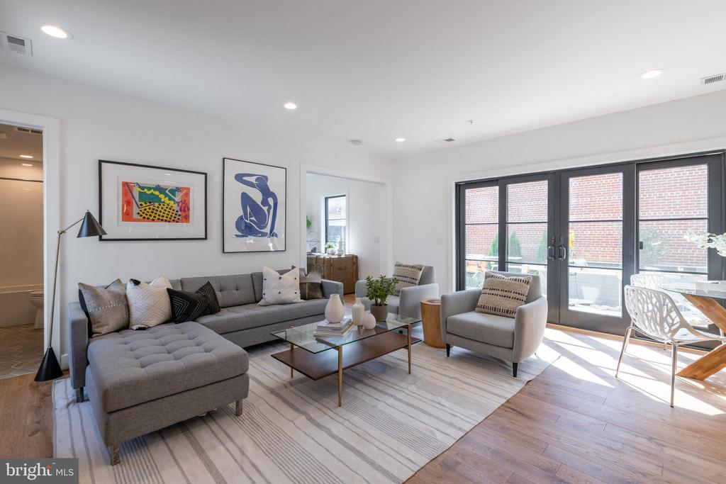 OPEN HOUSE: Sunday, October 4th: 2:00-4:00 PM.  Welcome to the Griffith!  Model Units now complete, staged and ready to show! This stunning property is an exciting new development by District Quarters in the charming and historic LeDroit Park neighborhood of Northwest DC. Nestled in between Shaw and Bloomingdale, Le Droit Park offers the convenience of restaurants and nightlife nearby, but boasts a quaint neighborhood atmosphere with many parks and old city charm! This thoughtfully designed building features nine brand new, incredibly spacious condominiums, designed to take advantage of the abundance of space and natural light.  Each unit includes solid oak hardwood floors, stainless steel appliances, and quartz countertops, which compliment the warm, contemporary style and unique craftsmanship this property has to offer.  All units have private outdoor space and the option to purchase storage and secured garage parking.  Unit #101 is a fantastic 3 bedroom/3 bathroom unit with a large open floor plan and private patio with greenery.  This property is not to be missed!