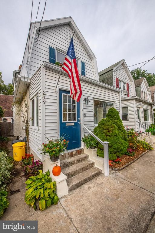 Adorable Single Family Home walkable to all that Ardmore has to offer yet tucked on a quiet dead-end street is waiting for its next owner.  From the wonderful front sun porch to the private rear slate patio this home exudes character and charm.  A cozy living room with a wood stove is adjacent to the dining room all with original hardwood flooring.  The updated kitchen features gas cooking and makes an enjoyable place to prepare meals.  The mudroom with a new washer and dryer is conveniently located off the kitchen and provides access outdoors to enjoy dining on your spacious patio bordered by colorful plantings and completely fenced for privacy.  Upstairs find the master bedroom featuring two closets, 2 additional bedrooms (1 currently used as a closet, but could be converted back), and an updated bathroom.  Fabulous location with a park at the end of the street, a short walk to Suburban Square, and an abundance of restaurants to choose from whether dining in or taking out to dine on your own patio-the Farmers Market, Iron Hill Brewery, and the train all within a short walk.  Plus Lower Merion Schools! New windows, water heater  (2018), and furnace (2017) with easy on-street parking. This won't last!   All showings start at OPEN HOUSE ON SUNDAY 9/27 1-3pm