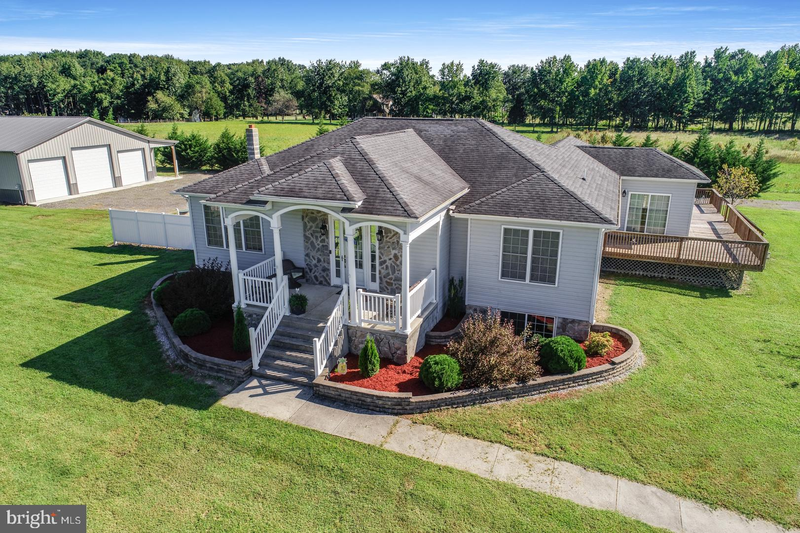 "This is the home you have been waiting for! 2.2 acres, with an oversized 50 x 60 pole barn,  custom kitchen cabinets, a partially finished basement, what more can you ask for?! Bring your boats, RV, Semi Trucks, race cars as a car lift is included! You can add a pool, a ""she shed"", another barn! Convert your new pole barn into a car enthusiasts dream, a crafters paradise, park your RV's, your boat, your campers, maybe even finish it into a hangout spot for Sunday night football! This property has endless possibilities! NO HOA, NO Deed Restrictions! As you walk up to this home you will be impressed by the stone on the front of the home, the beautifully welcoming stair case, the vinyl railing front porch. This home features beautiful solid surface flooring throughout, an elaborate tile fire place in the living room, an open floor plan with plenty of windows! The kitchen is a chefs dream with granite counter tops, custom cabinetry, stainless appliances with an in wall oven, gas cooktop with vent fan hood, a pot filler, and HUGE island over looking the main living space! The full 4 piece master bath features tile, granite, more custom cabinets, a corner jetted tub, and a tile shower with 2 shower heads and glass shower doors! This home features a full basement that is partially finished and ready for your custom touches! Dont forget the huge rear deck overlooking this beautiful property. Schedule your tour today!"