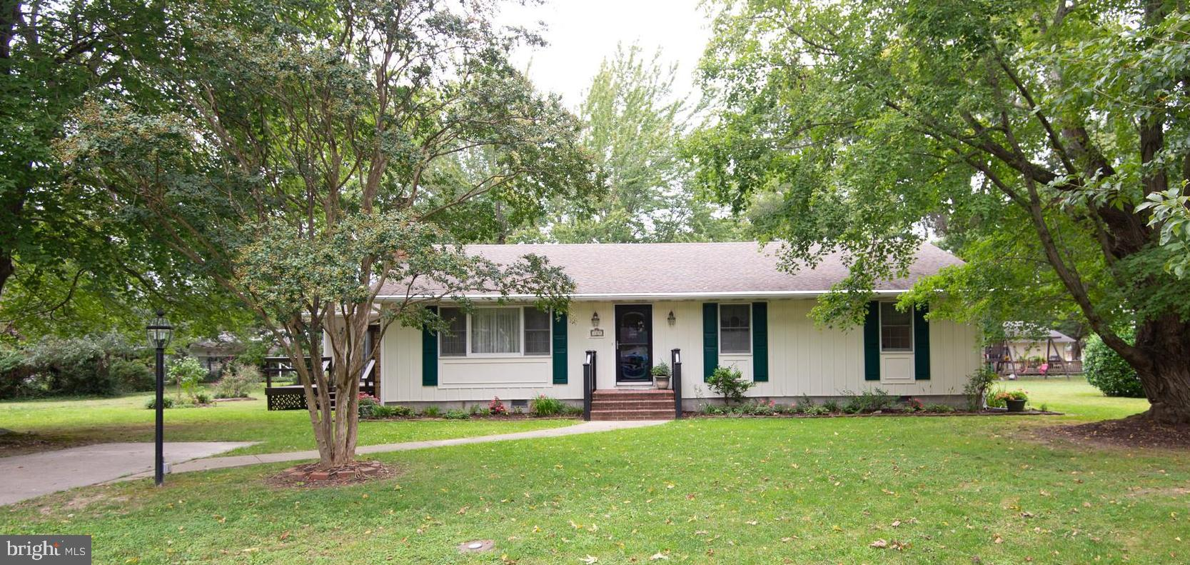 Attention has been paid to every detail in this 3 bedroom, 2 bath home. Cozy living room with fireplace opens to the kitchen and dining room. Granite counter tops. Glass enclosed porch.